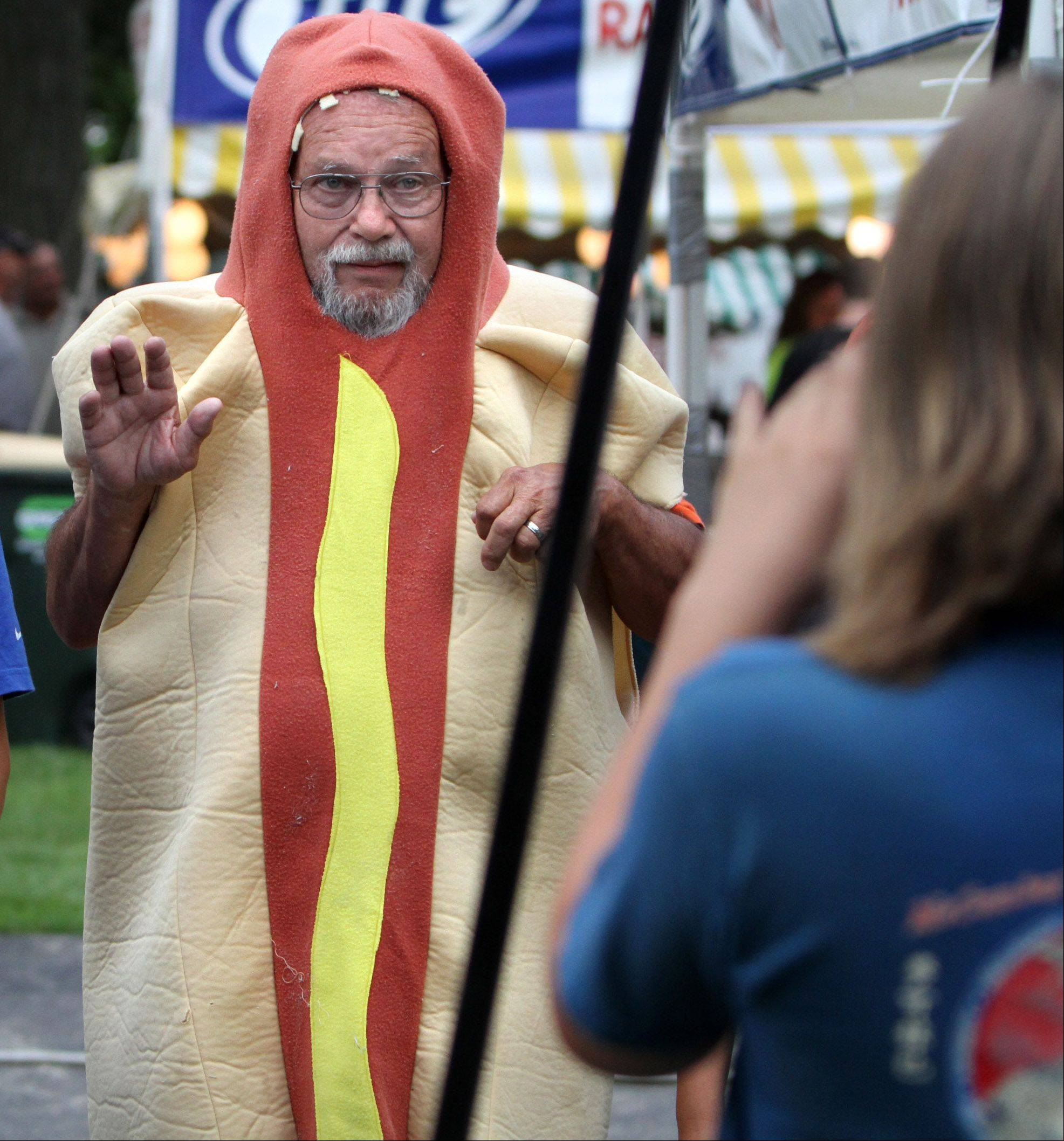 Tony Musur gets a photo taken as he tries to round up contestants last year for the first hot dog-eating contest at Lakemoor Fest. More contestants are expected this year for the contest scheduled for 7 p.m. Friday.