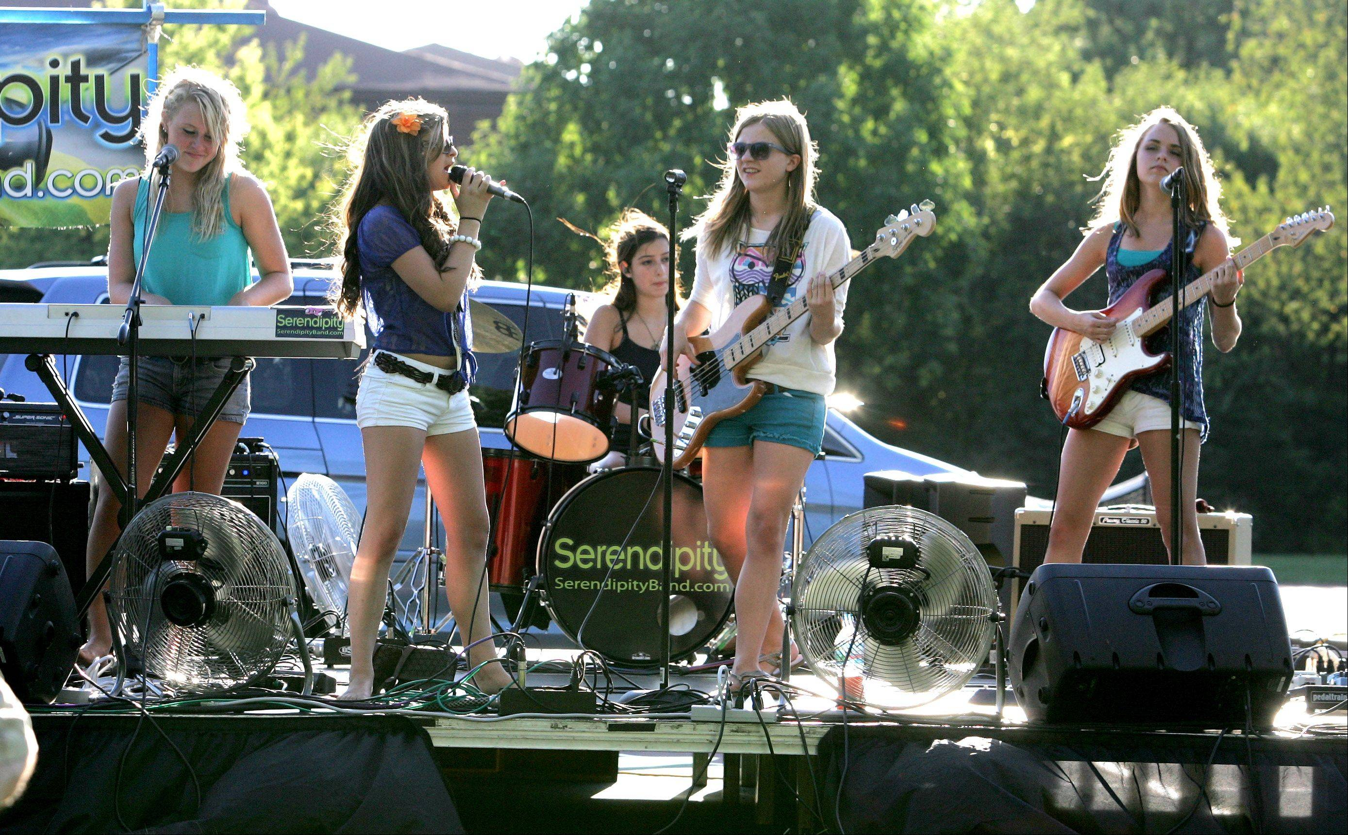 The band Serendipity plays during National Night Out at Community Park in Carol Stream on Tuesday.