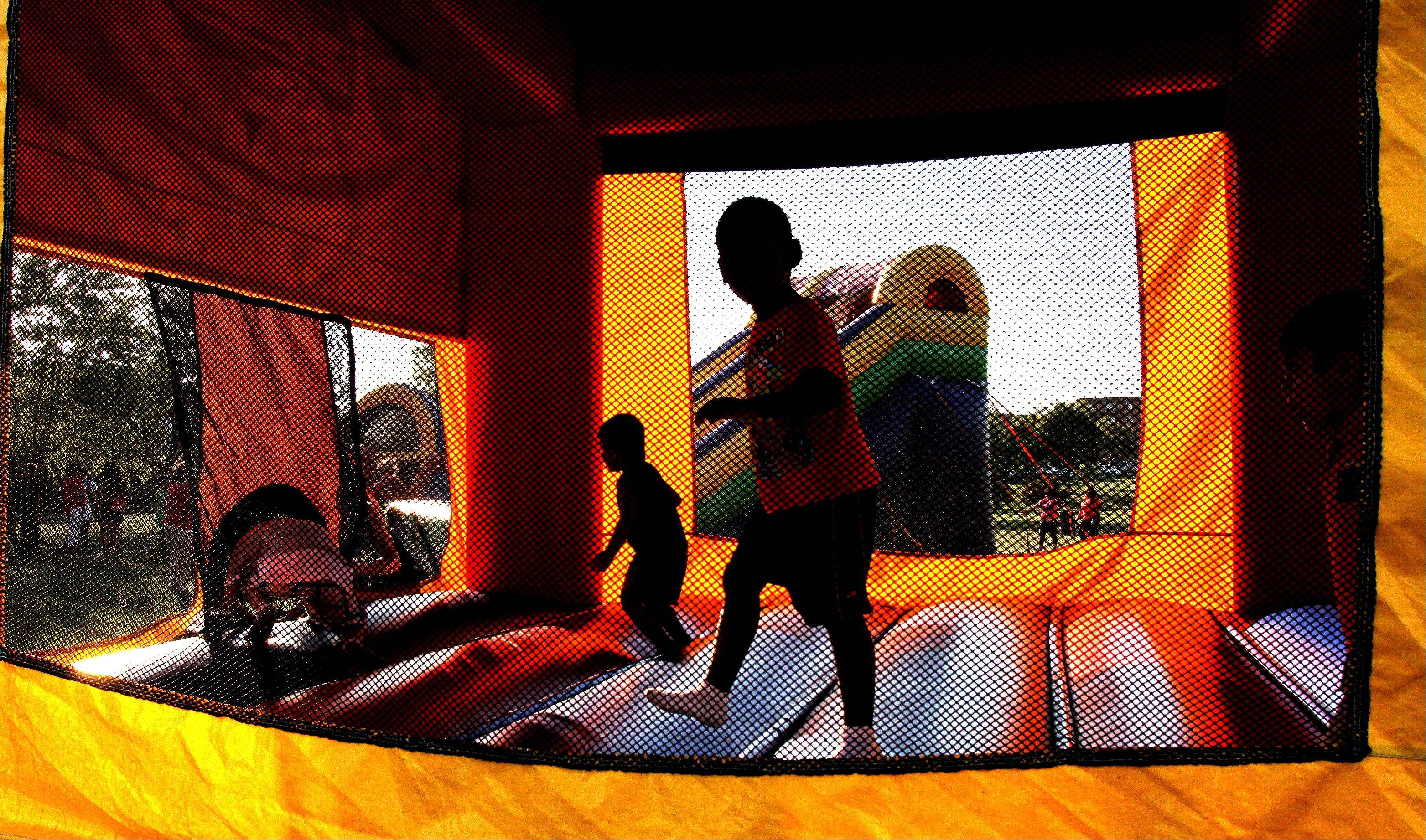 Inflatable bouncers and slides were part of the fun at National Night Out at Community Park in Carol Stream on Tuesday.