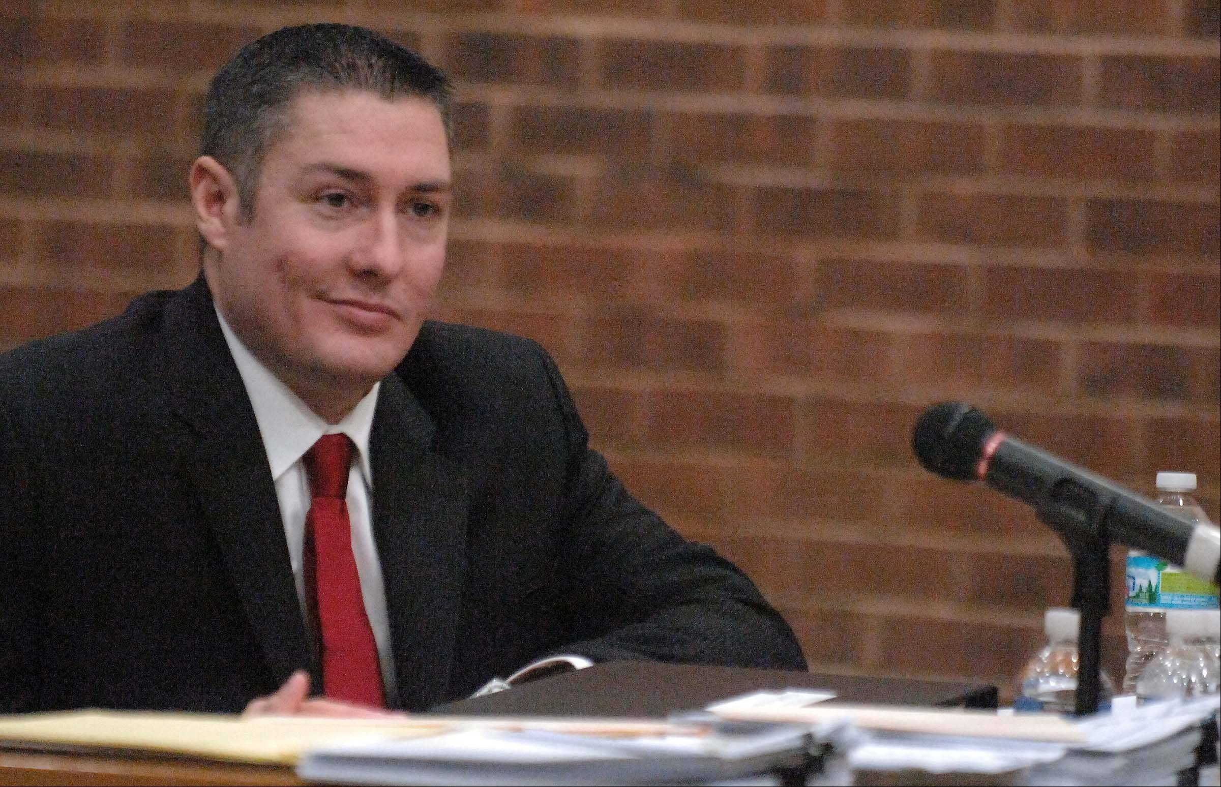 Former Oak Brook police officer Stephen Peterson, son of murder suspect Drew Peterson, attends a hearing before the village board of police and fire commissioners in February 2011.