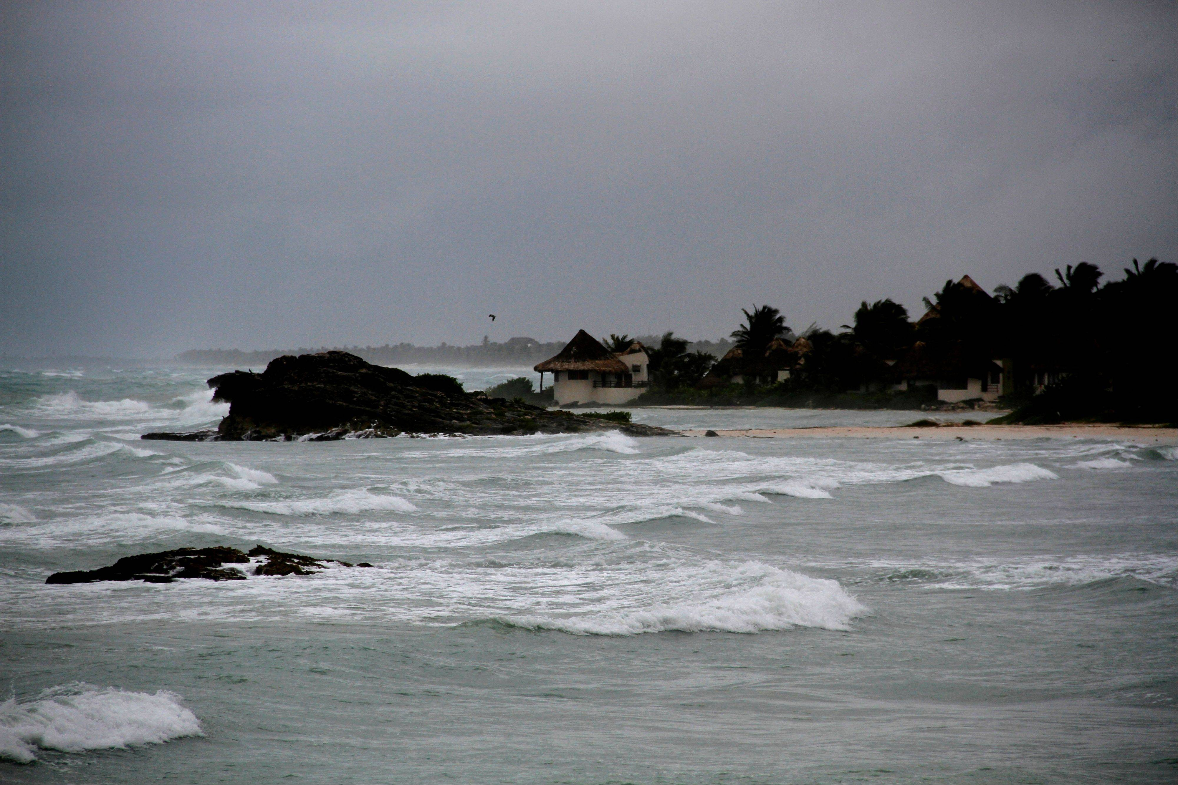 View of the beach in Tulum, Mexico, Tuesday, as Tropical Storm Ernesto brings the threat of hurricane-force winds and torrential rains to the Caribbean coast. The heart of the storm was expected to hit south of Cancun and the Riviera Maya.