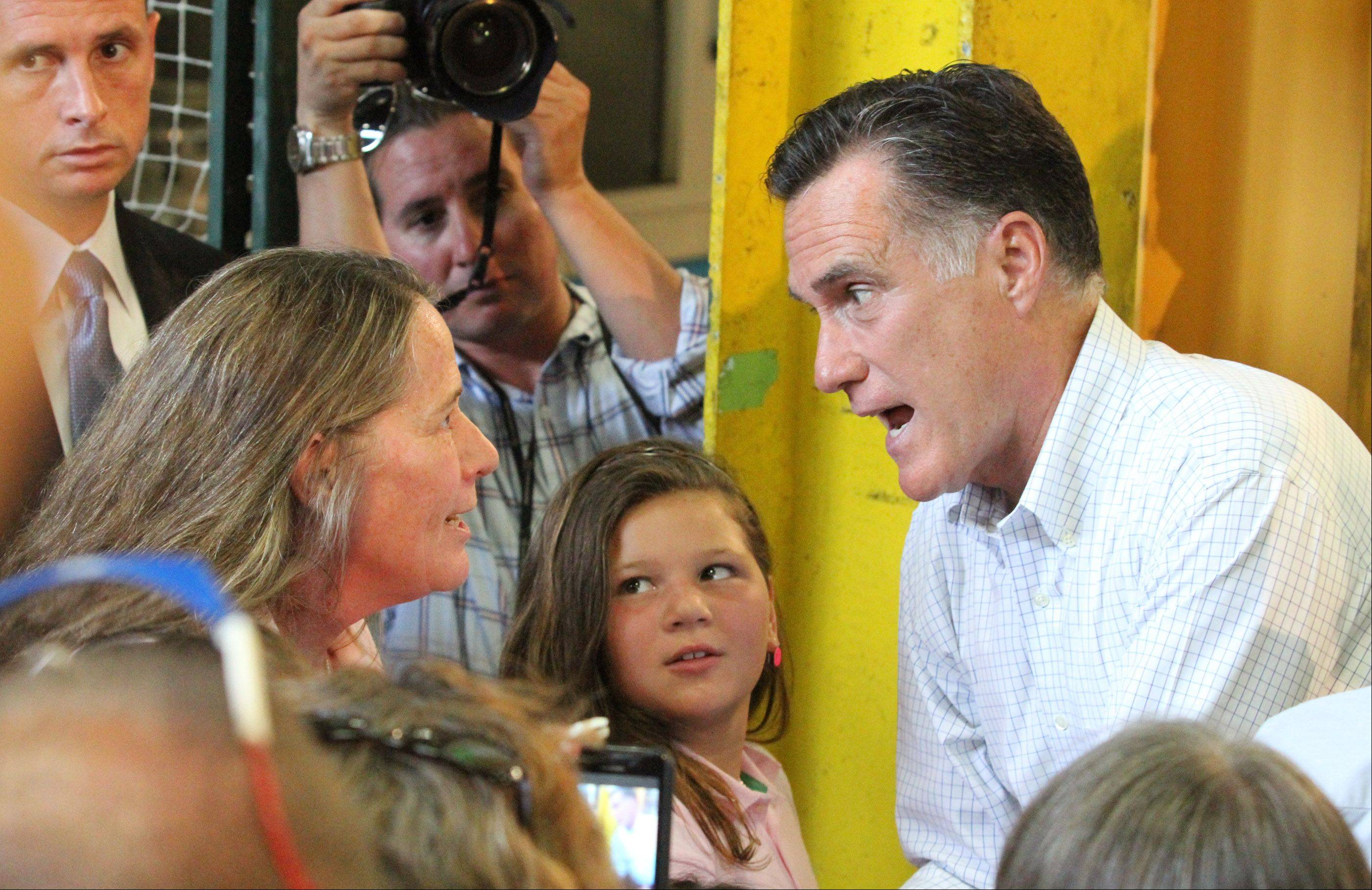 Sharon Meroni, director of Defend the Vote, of Barrington, speaks with GOP Presidential candidate Mitt Romney after a campaign speech at Acme Industries in Elk Grove Village on Tuesday, August 7.