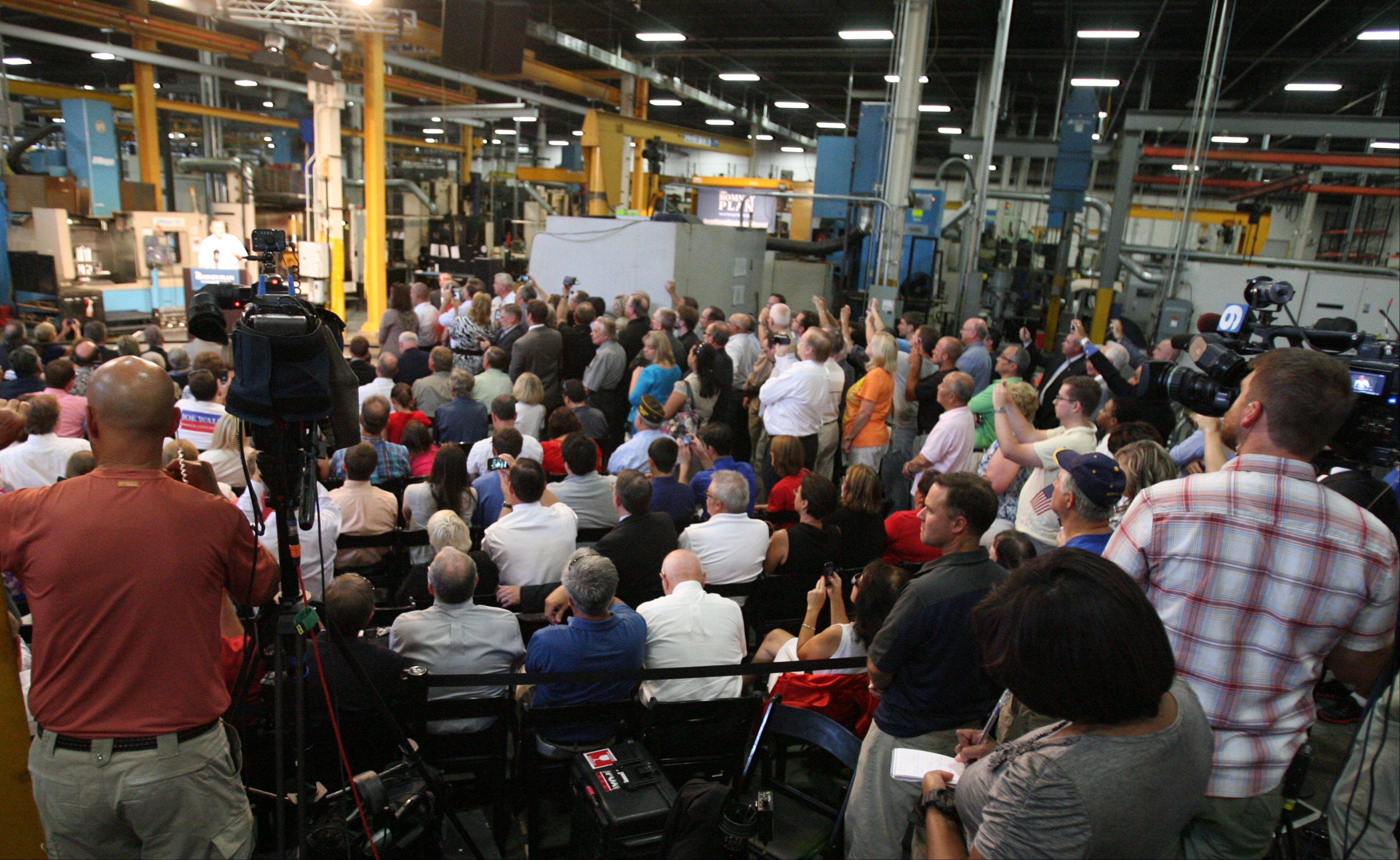GOP Presidential candidate Mitt Romney speaks to supporters at Acme Industries in Elk Grove Village on Tuesday, August 7.