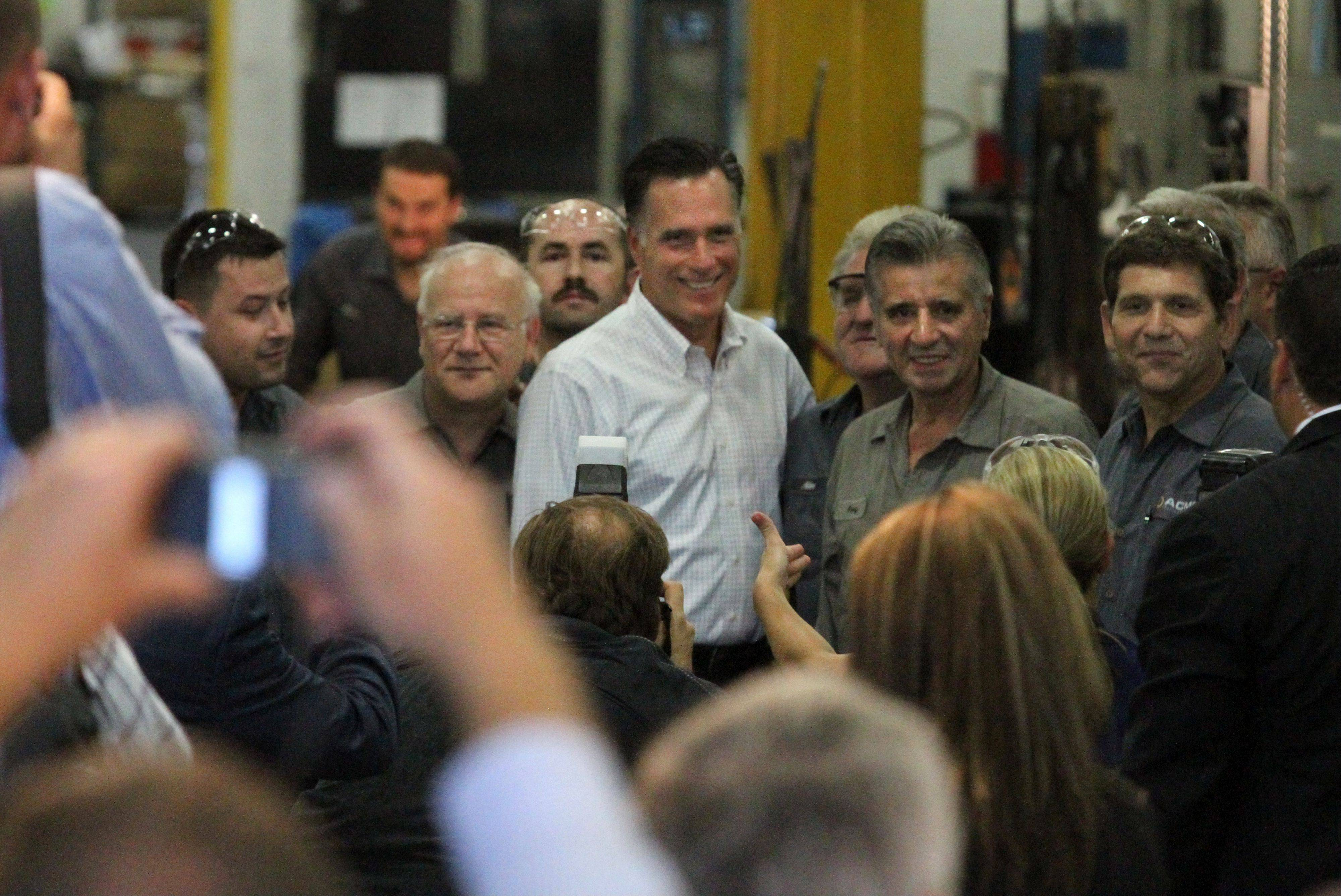 GOP Presidential candidate Mitt Romney poses for a photograph with workers at Acme Industries in Elk Grove Village on Tuesday, August 7.