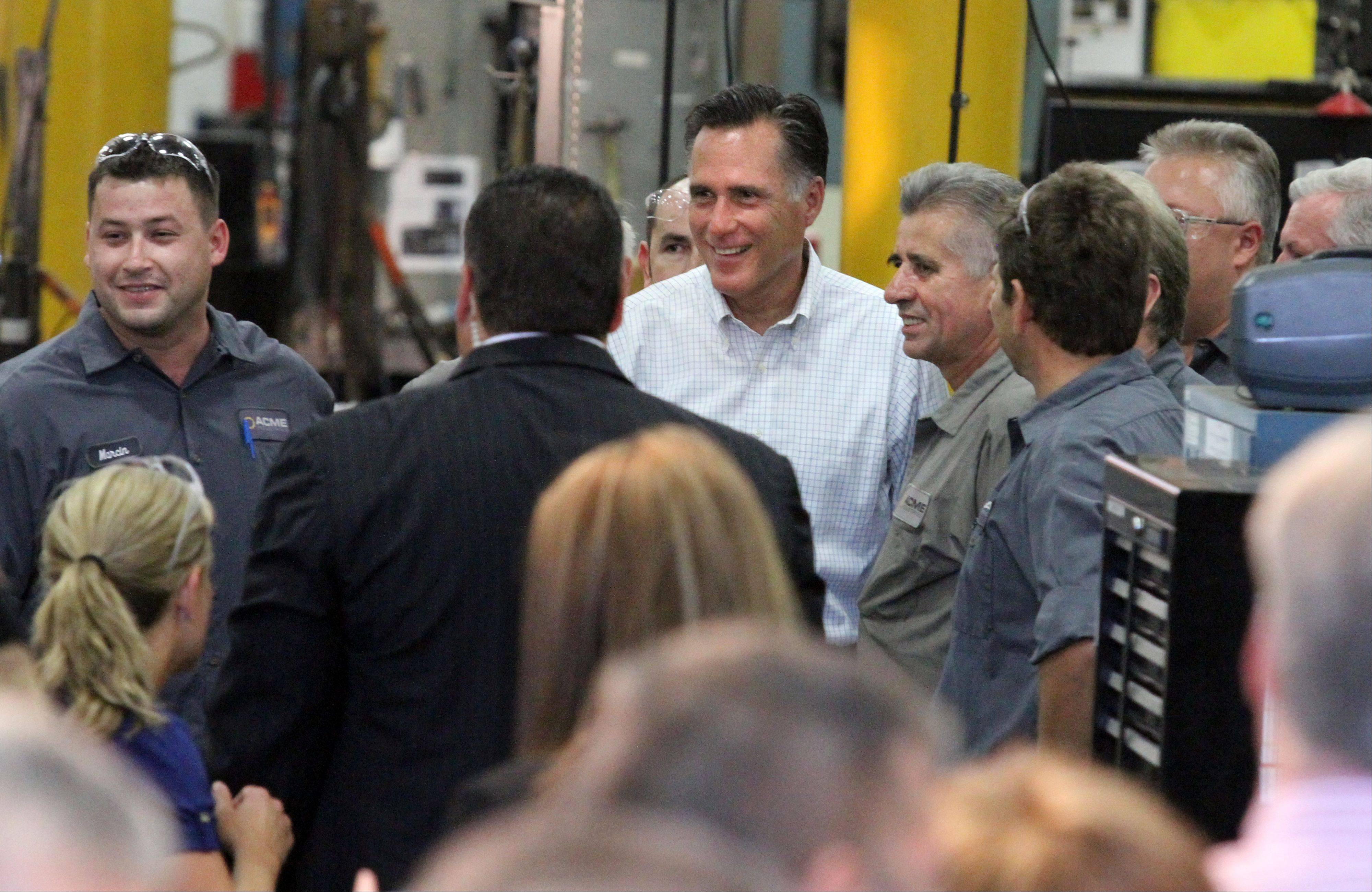 GOP Presidential candidate Mitt Romney speaks with workers at Acme Industries in Elk Grove Village on Tuesday, August 7.
