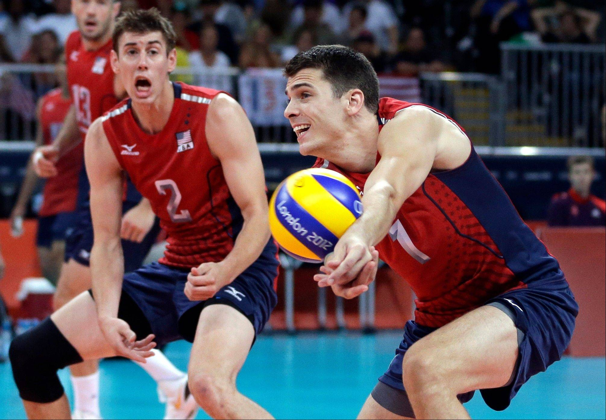 Associated PressTeam USA's Matthew Anderson passes the ball as teammate Sean Rooney, a Wheaton native, watches Saturday during a men's preliminary volleyball match against Russia at the London Olympics.