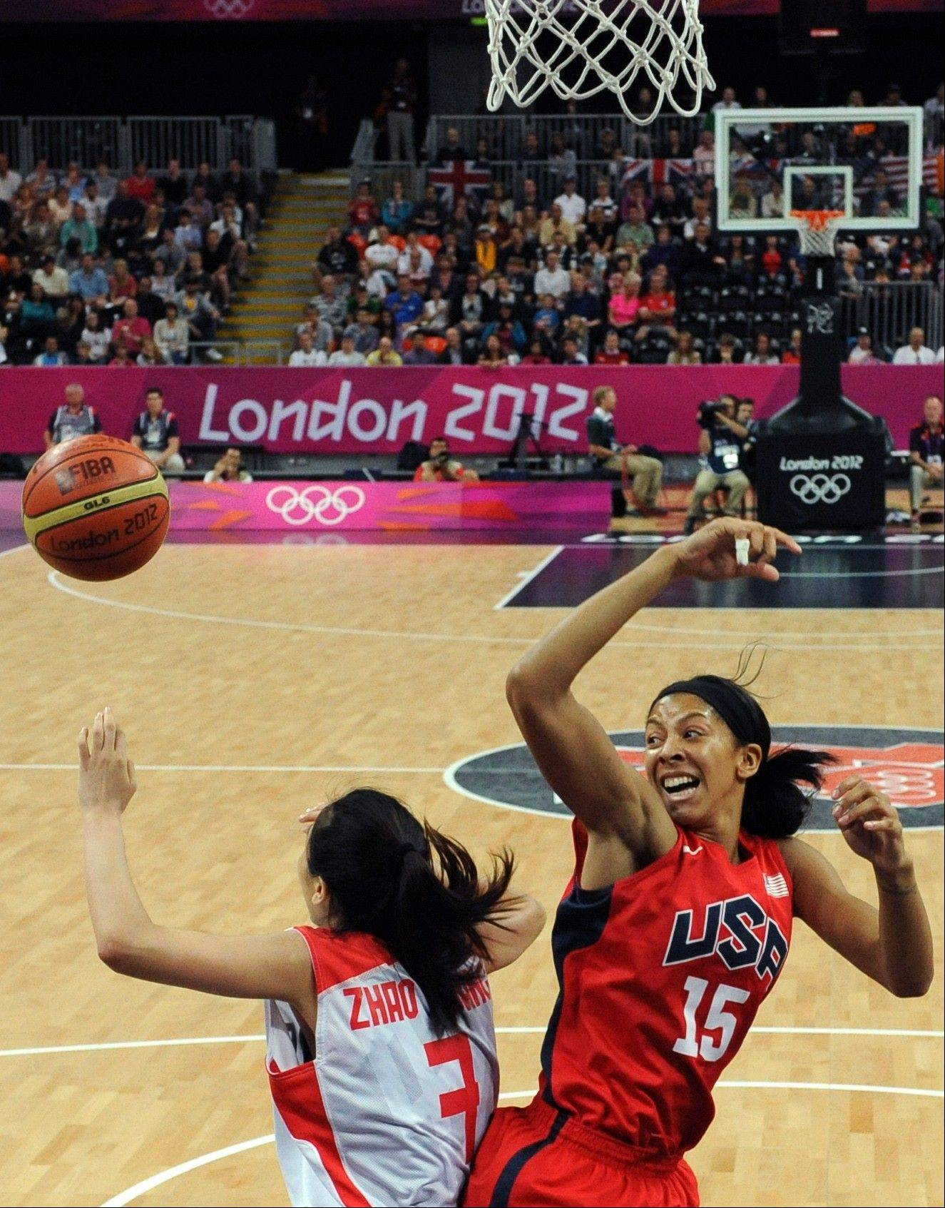 Chinese guard Zhao Shuang vies for the ball with Naperville native Candace Parker of Team USA during their preliminary round basketball game Sunday at the London Olympic.