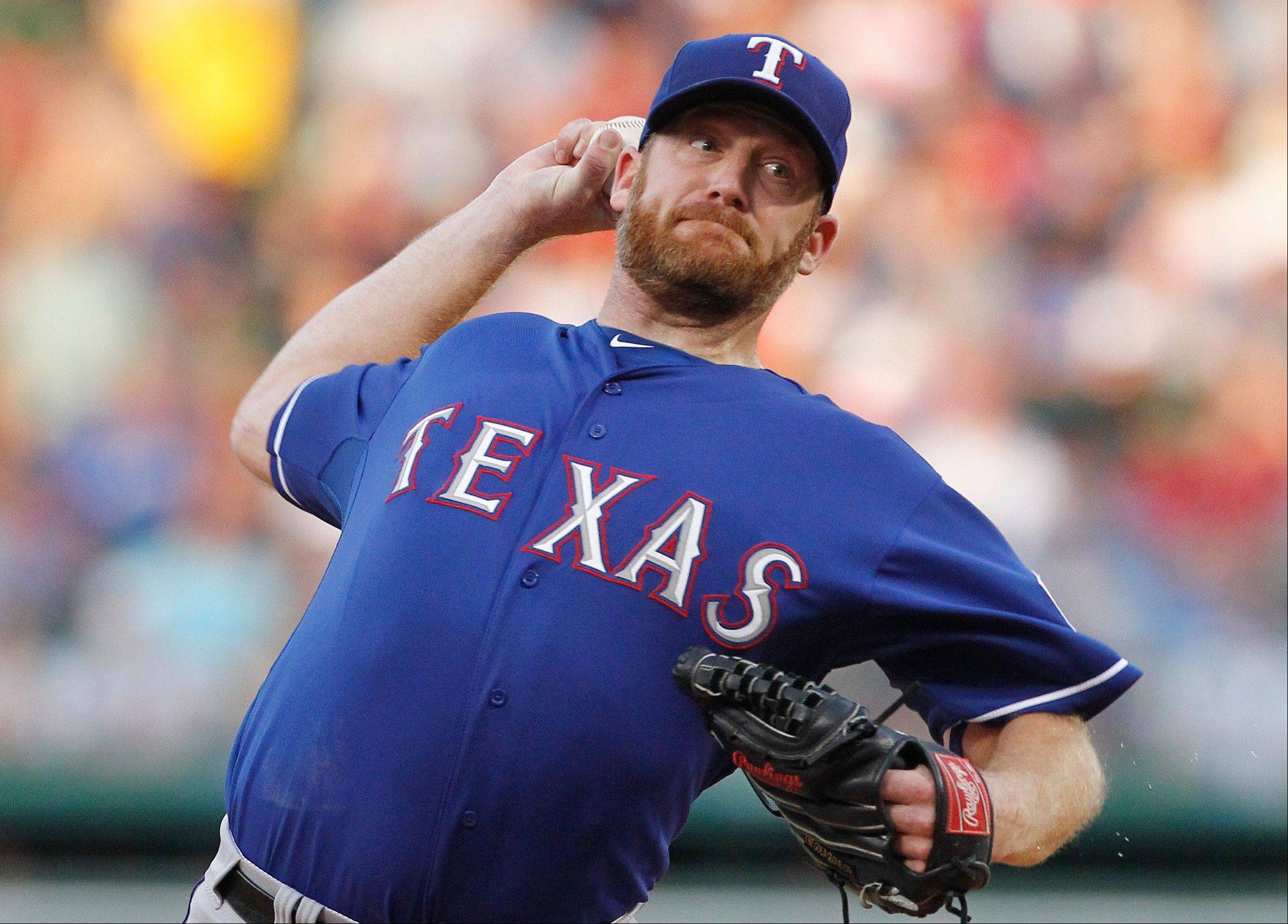 The Rangers' Ryan Dempster struck out six and walked one in 6 2-3 innings Tuesday in Boston.