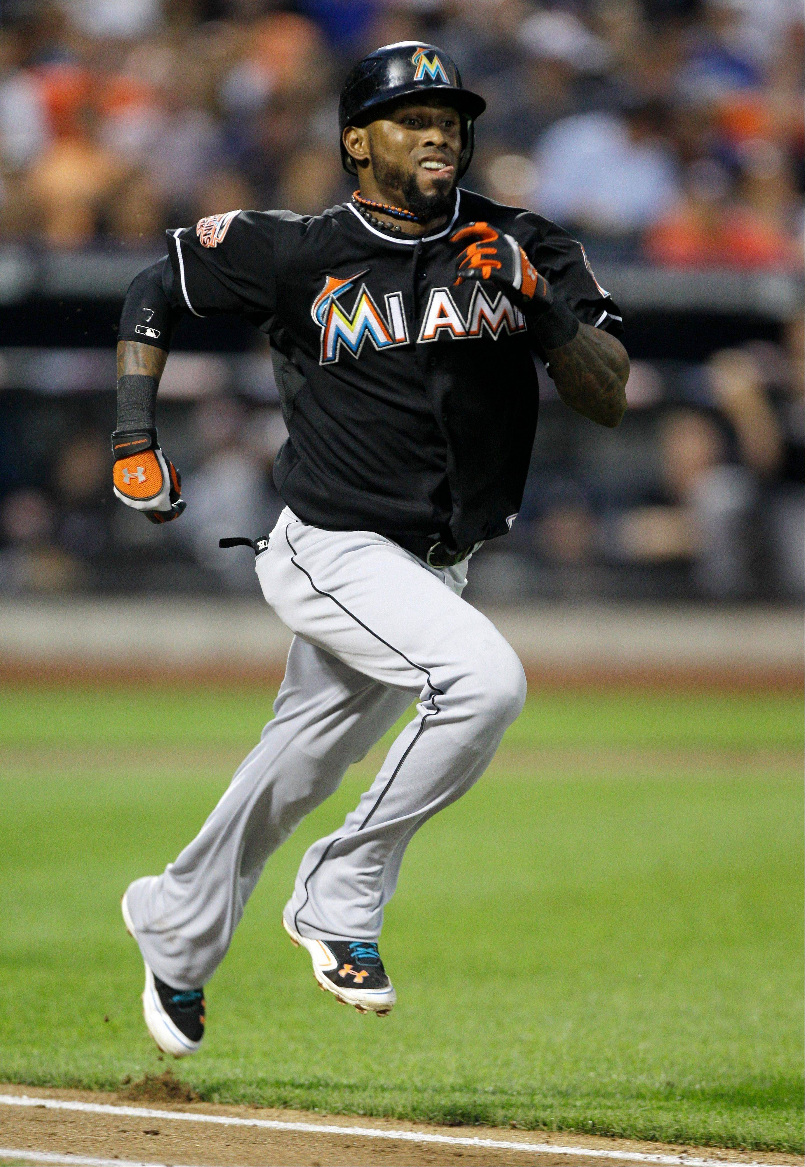 The Marlins' Jose Reyes runs out a fourth-inning infield single Mets starting pitcher Jonathon Niese, extending his hitting streak to 25 games, Tuesday in New York.