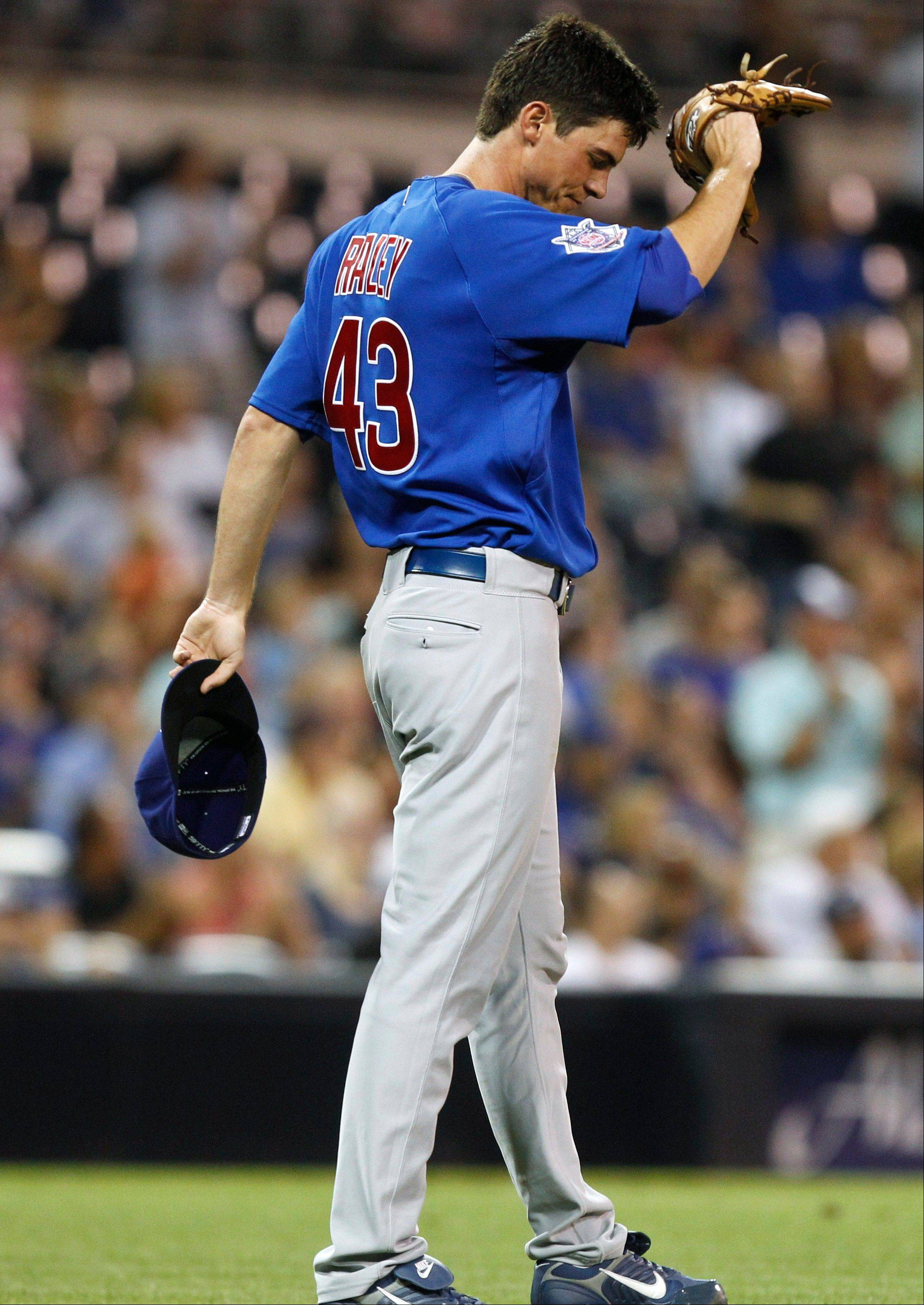 Cubs starter Brooks Raley wipes his brow after surrendering a 3-run home run to the Padres' Carlos Quentin during the fourth inning Tuesday night. Raley lasted 4 innings and gave up 7 runs and 8 hits.