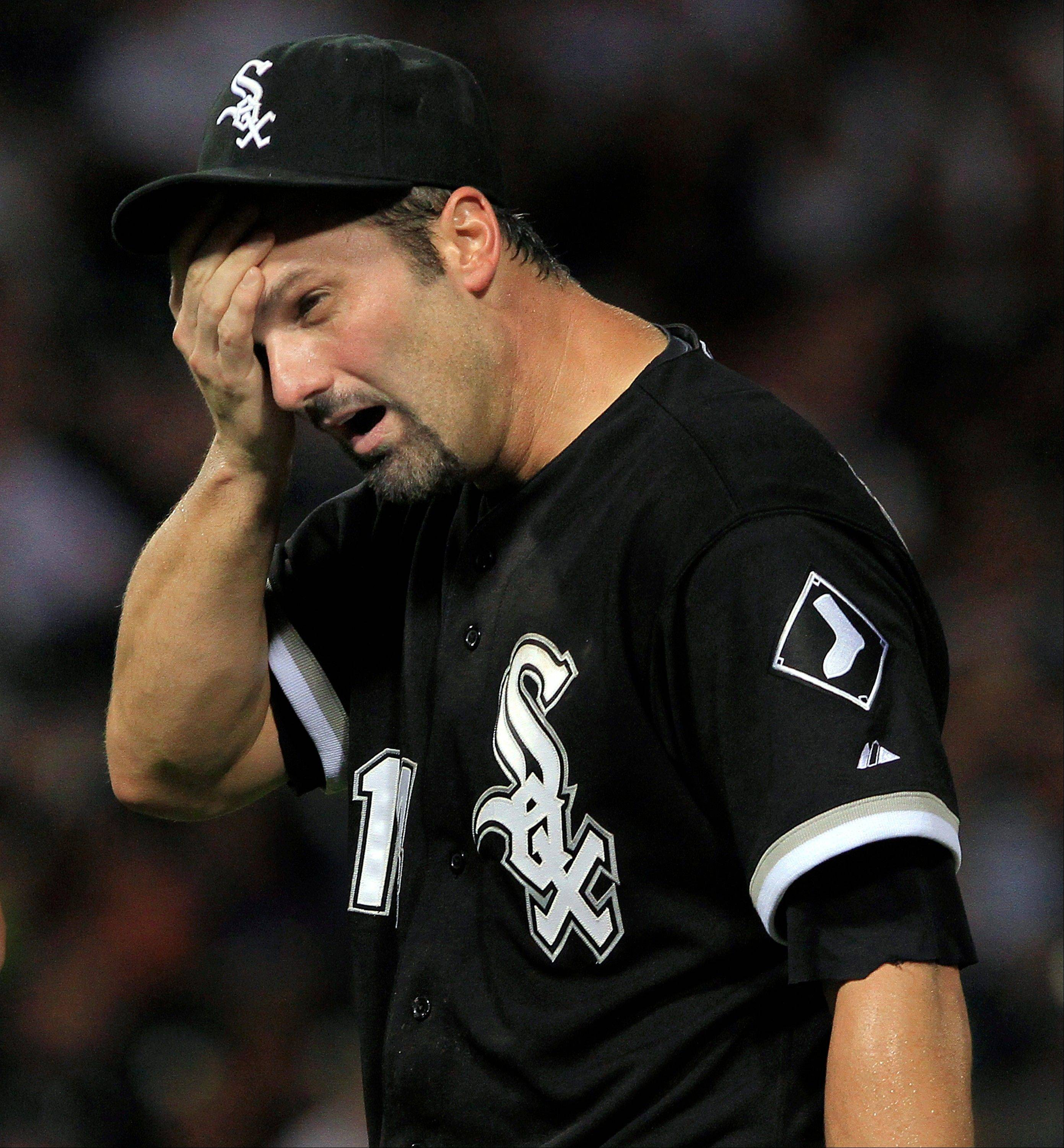 White Sox first baseman Paul Konerko holds his head after colliding with the Kansas City Royals' Jarrod Dyson Tuesday during the seventh inning.