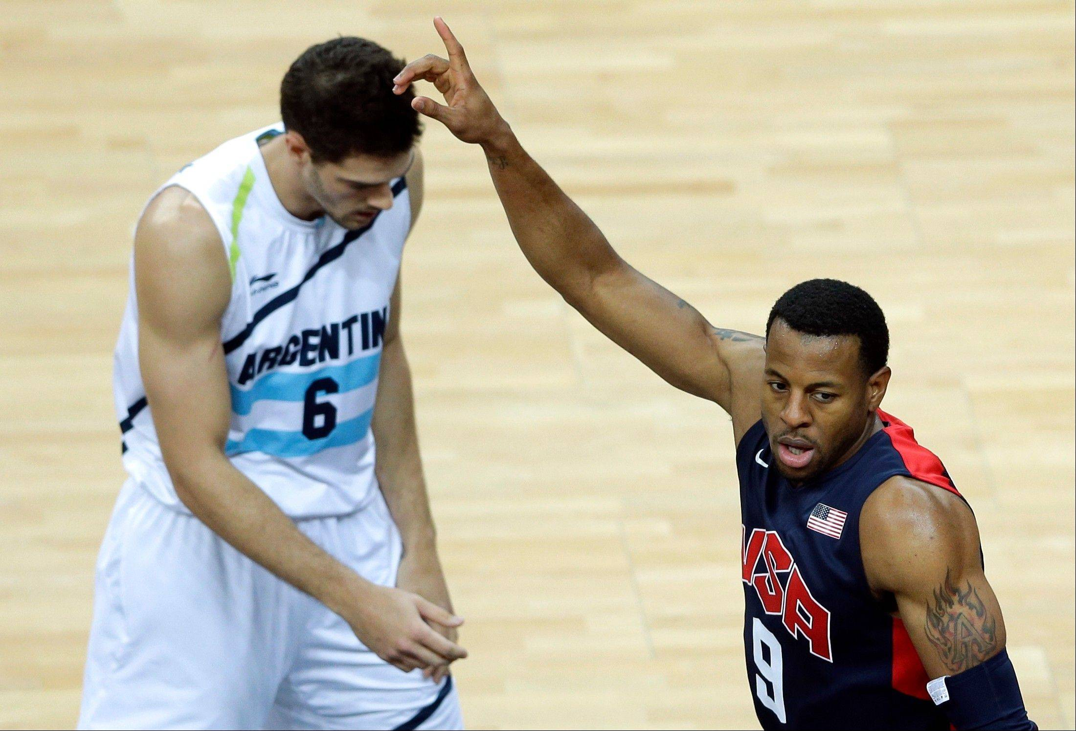 The United States' Andre Iguodala, right, celebrates Monday next to Argentina's Marcos Mata, left, in the second half.