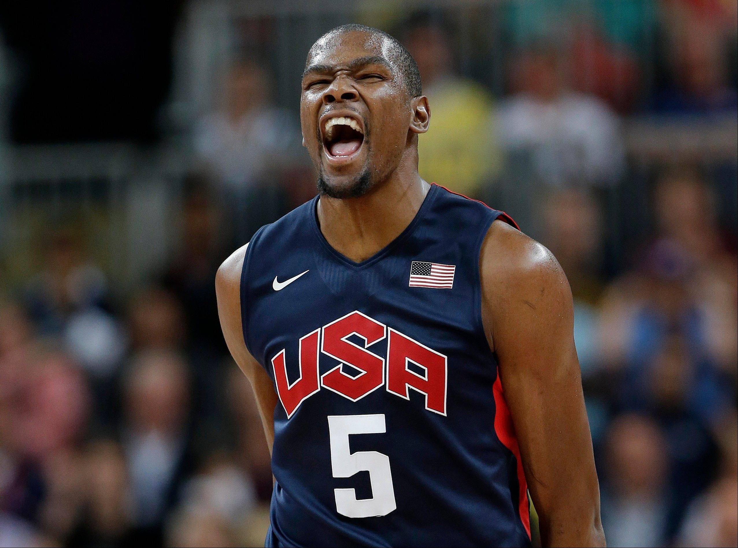 USA forward Kevin Durant reacts Monday after hitting a three pointer during a preliminary game against Argentina.