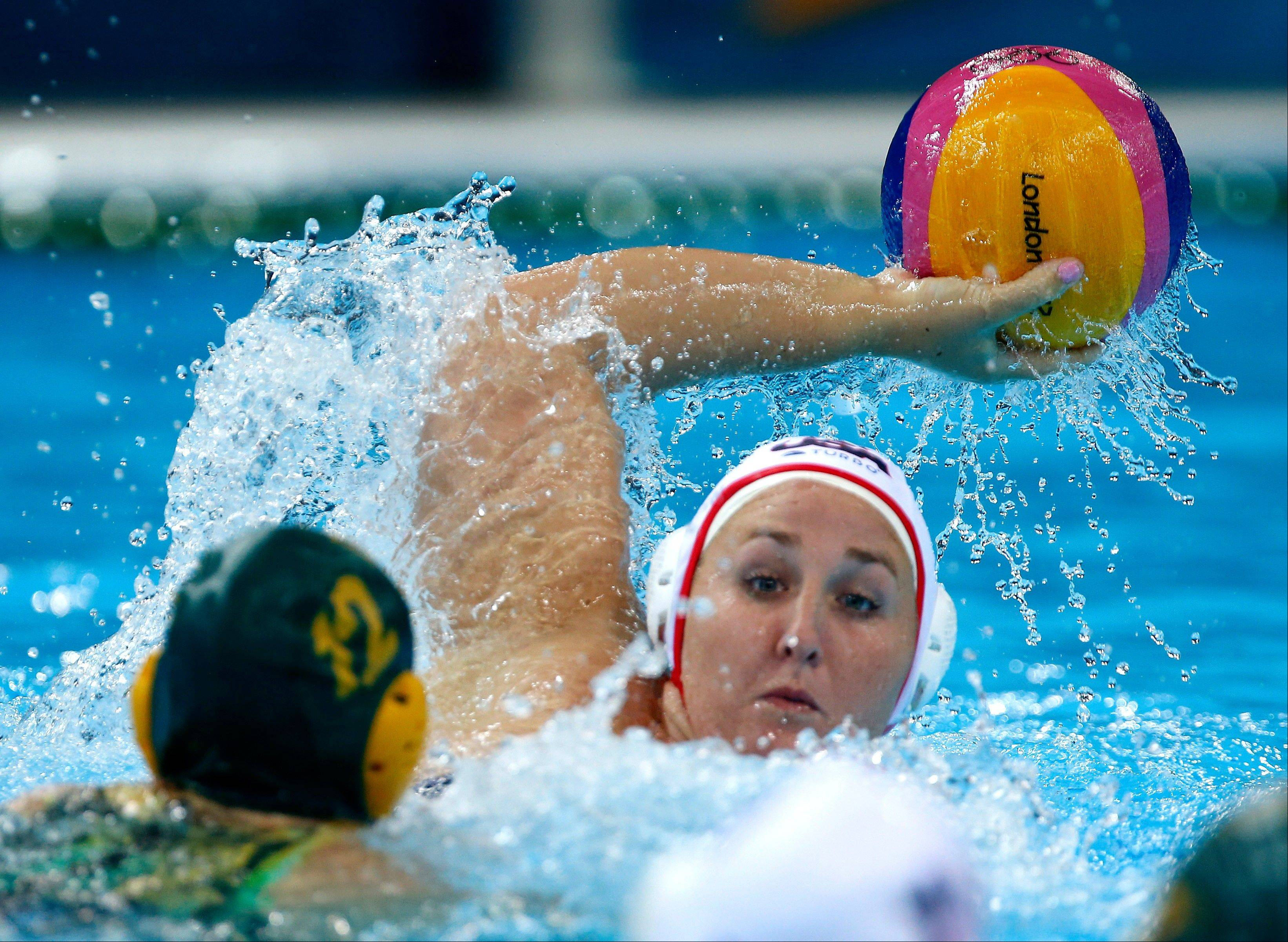 Melissa Seidemann, right, of the United States looks to pass against Nicola Zagame of Australia Tuesday during a women's semifinal water polo match at the 2012 Summer Olympics.