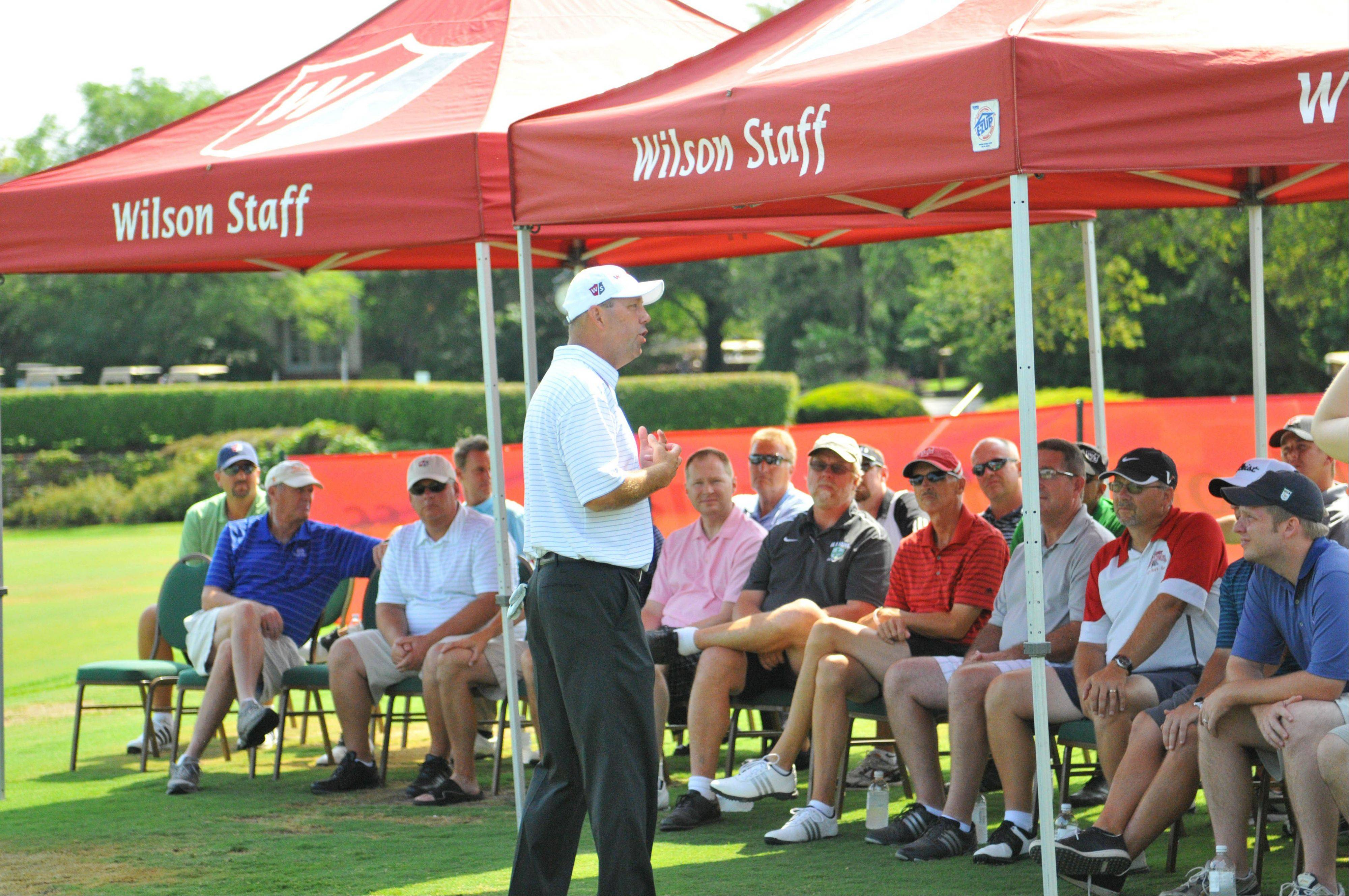 Mike Small, head golf coach at the University of Illinois, answers questions posed by high school coaches attending a recent clinic at Naperville Country Club. This week Small is playing in the PGA Championship.