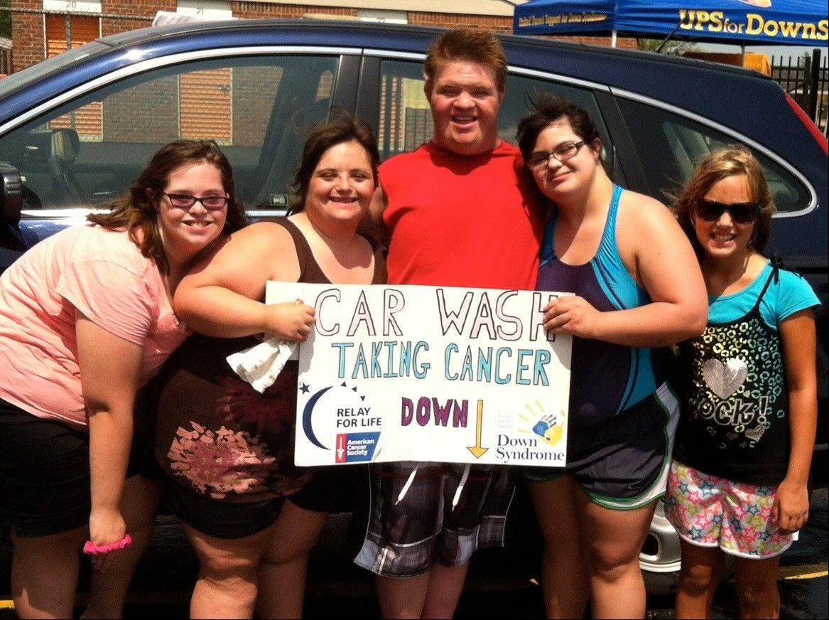 Kelsey Nolan of Elk Grove Village, Allie Reninger of Schaumburg, Danny Orlando of Bartlett, Julia Neri of Schaumburg and Alana Herr of Arlington Heights pose for a photo at the UPS for DownS car wash fundraiser to support the American Cancer Society.
