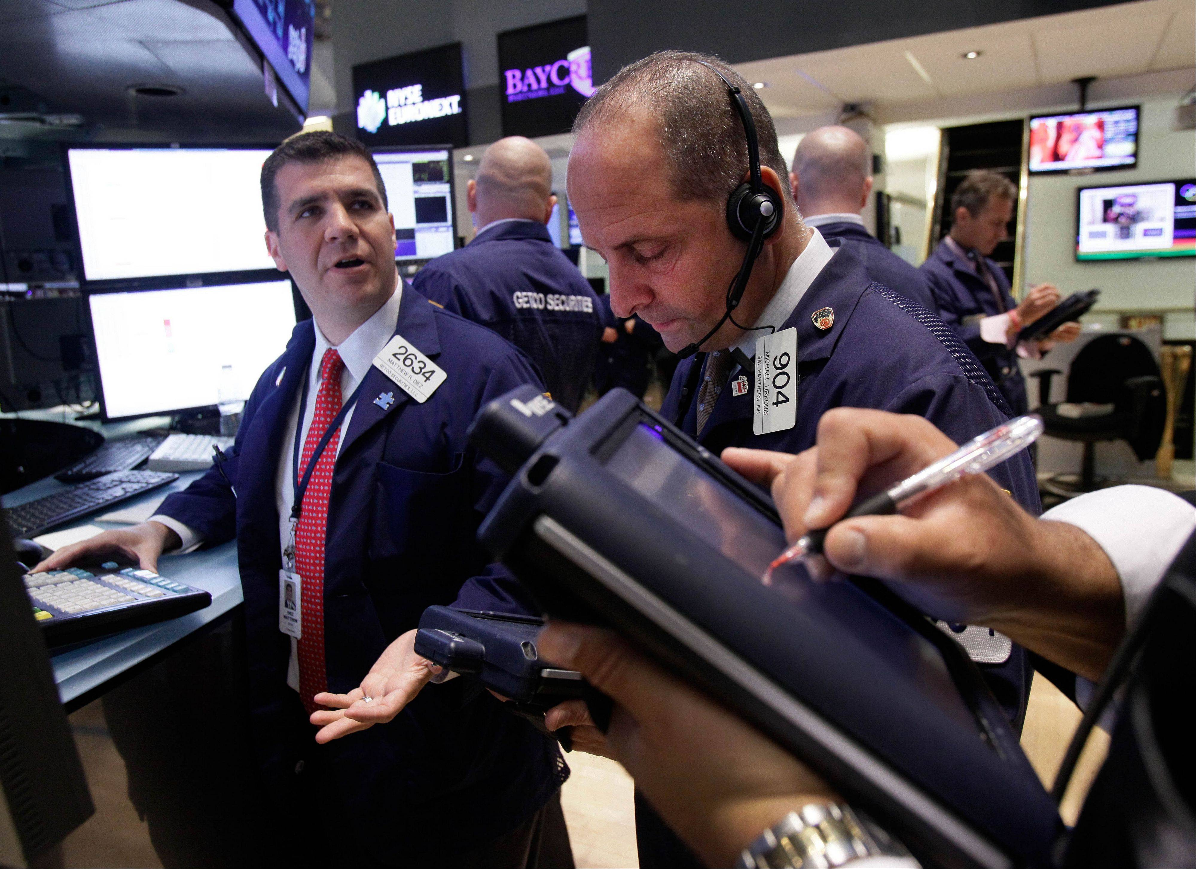 U.S. stocks fell modestly Wednesday after worrisome economic reports from England and France.