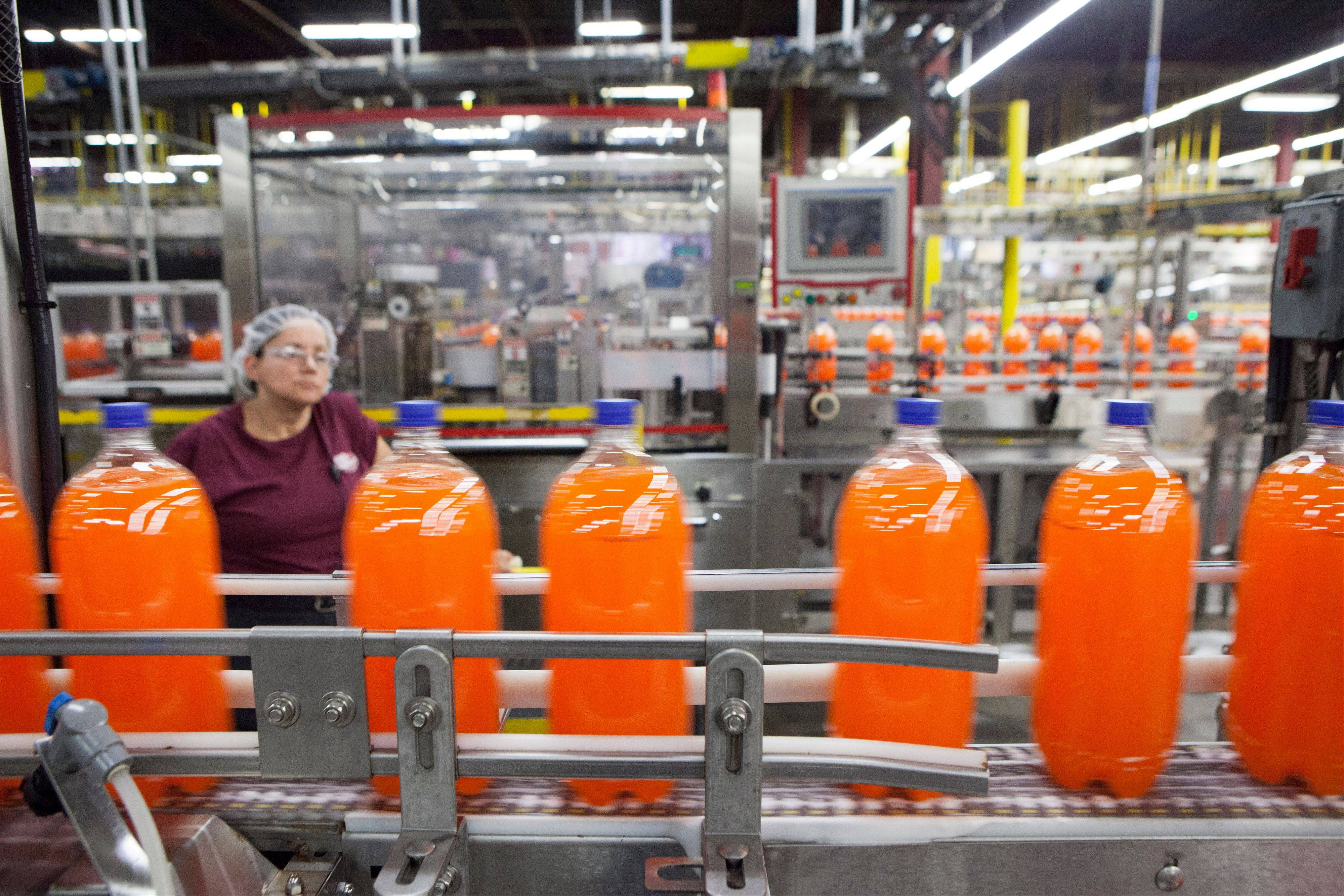 Bottles of Sunkist move down the line at the Dr Pepper Snapple bottling plant in Houston. Beverage companies have been teaming up with environmental groups to preserve and conserve water and watersheds, most recently Dr Pepper with the Nature Conservancy on watersheds that the company draws on directly for its product.