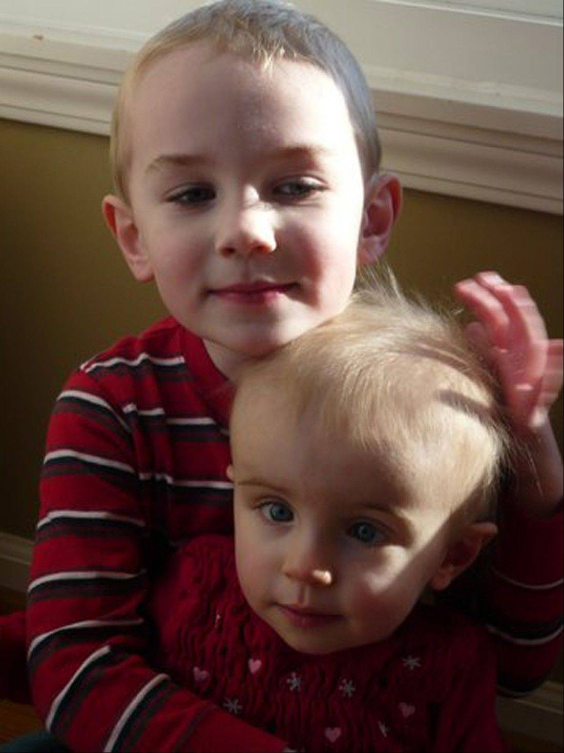 Friends and family of Paige Cichon, 2, shown getting a hug from older brother Will, 3, are able to keep up with her progress through caringbridge.org.