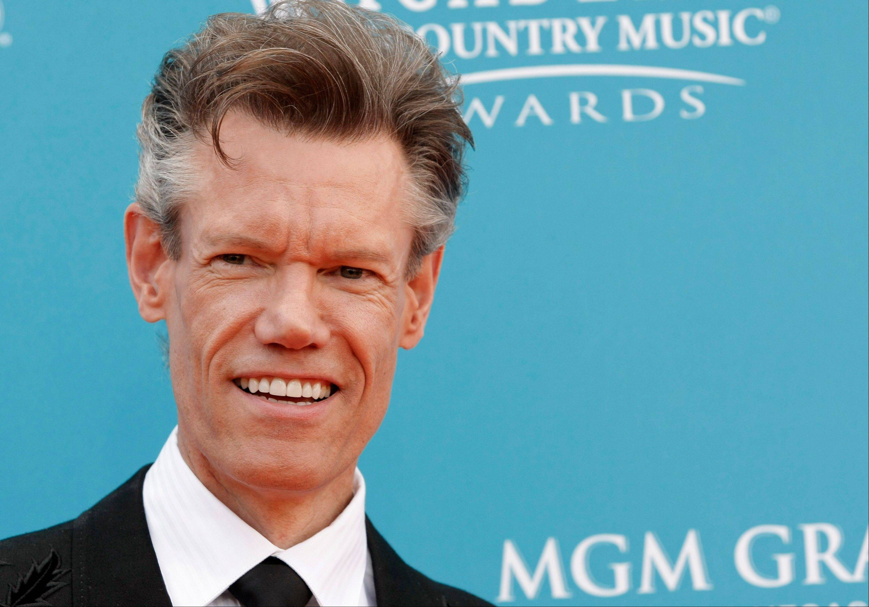 Randy Travis has been charged with driving while intoxicated in North Texas after a single-car crash Tuesday night.