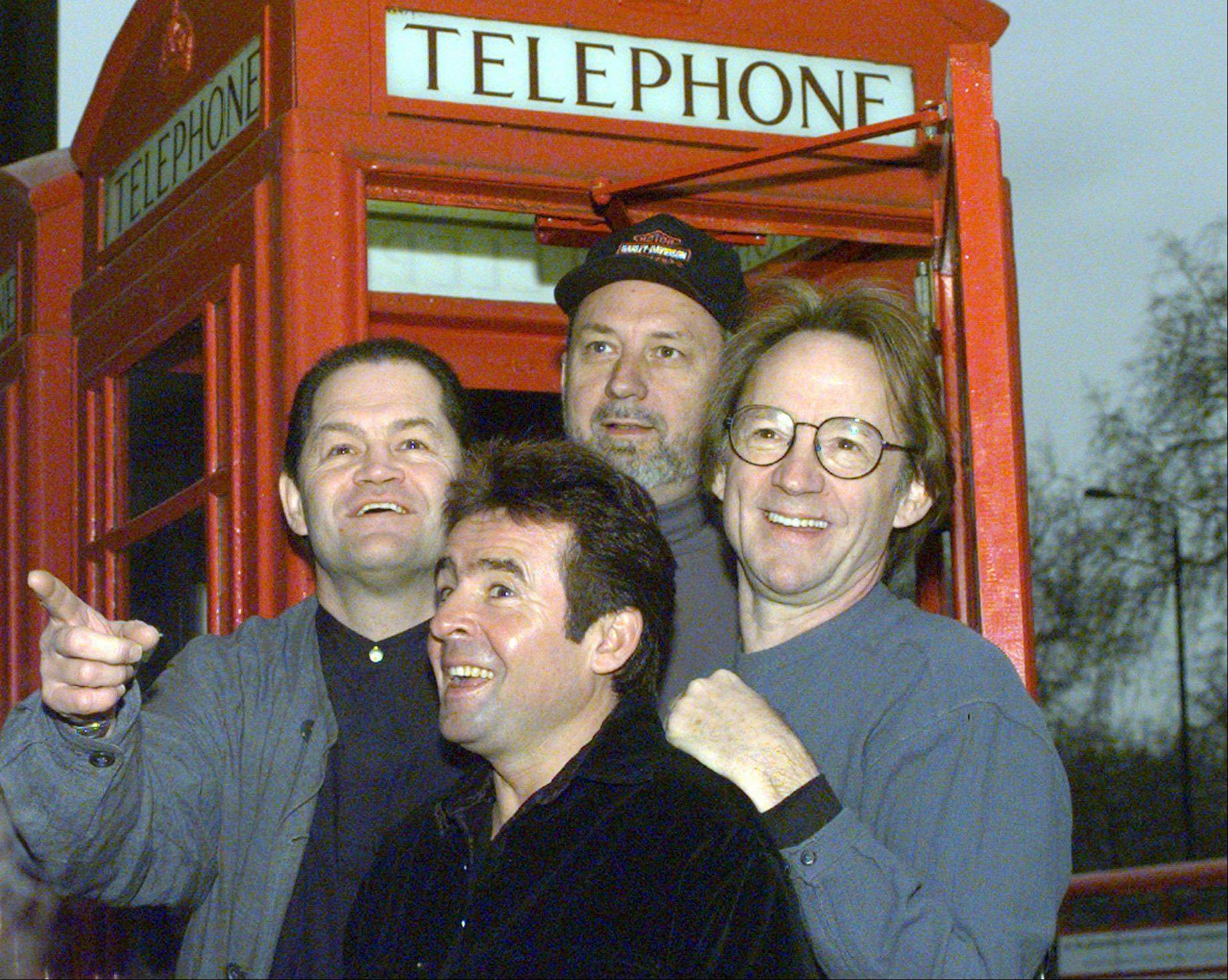 Micky Dolenz, left, Mike Nesmith and Peter Tork of The Monkees (shown in 1997) announced Wednesday that the group will launch a 12-date U.S. tour in November. It's the band's first tour since Davy Jones, front, died in February.