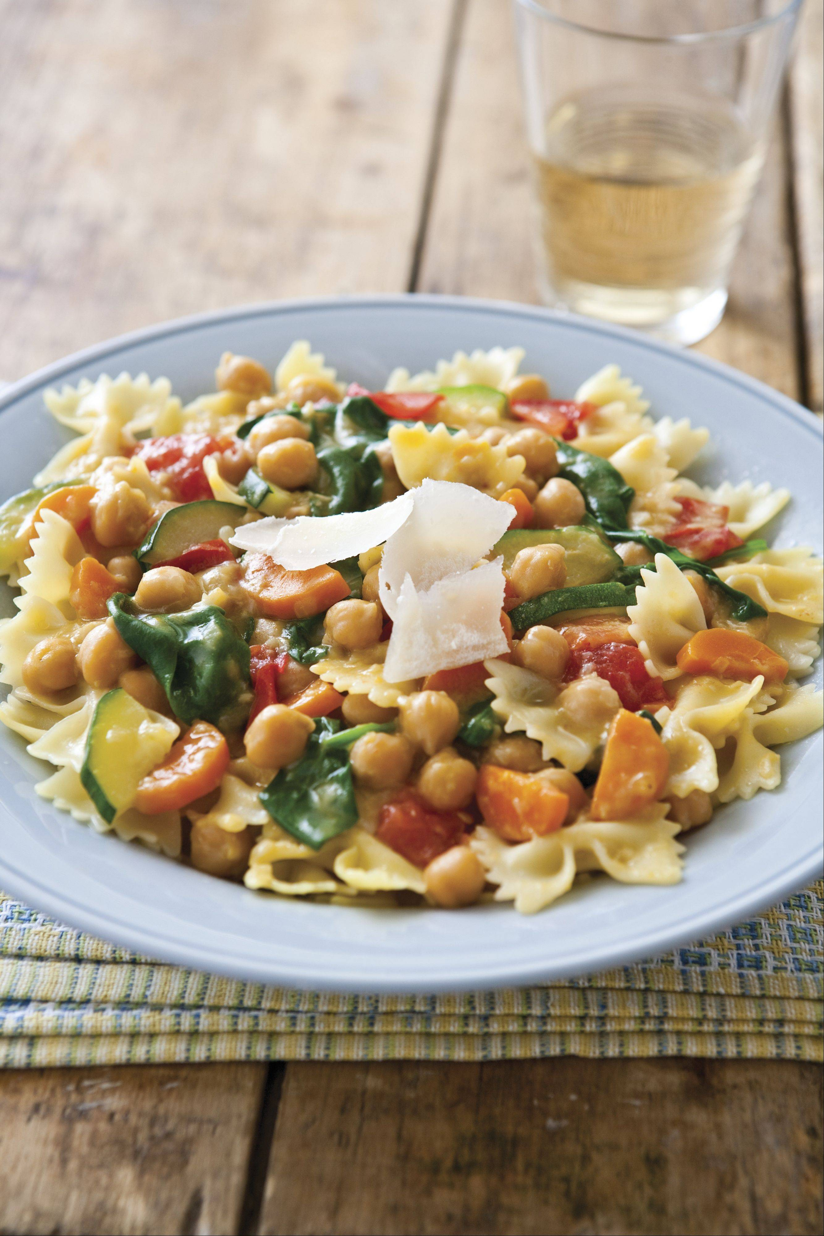 Chickpeas, carrots and other garden vegetables make a healthy, slow-cooked sauce for pasta.