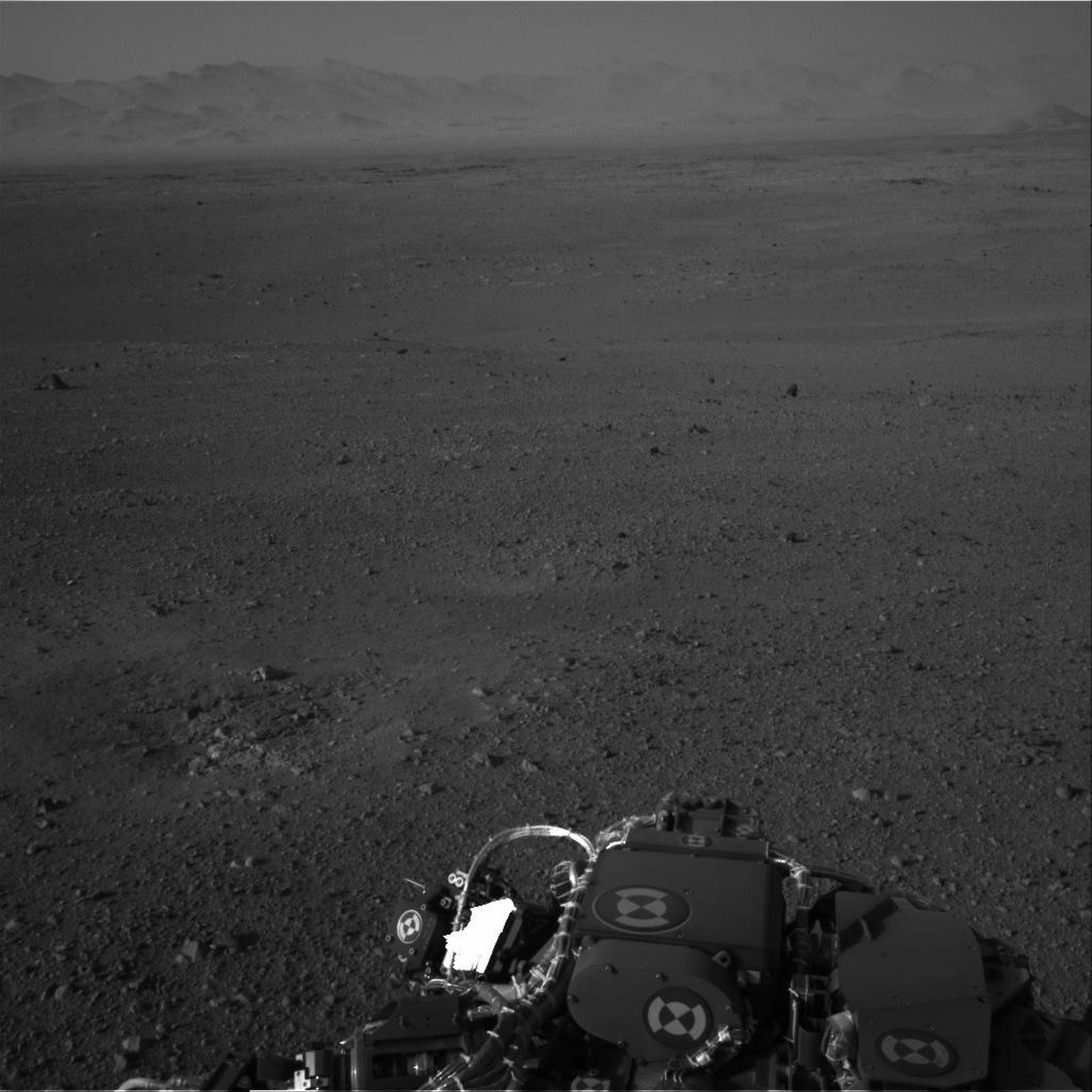 This image released by NASA on Wednesday Aug. 8, 2012 taken by cameras aboard the Curiosity rover shows the Martian horizon. It's one of dozens of images that will be made into a panorama. Curiosity landed on August 5, 2012 on a two-year mission to study whether its landing site ever could have supported microbial life.