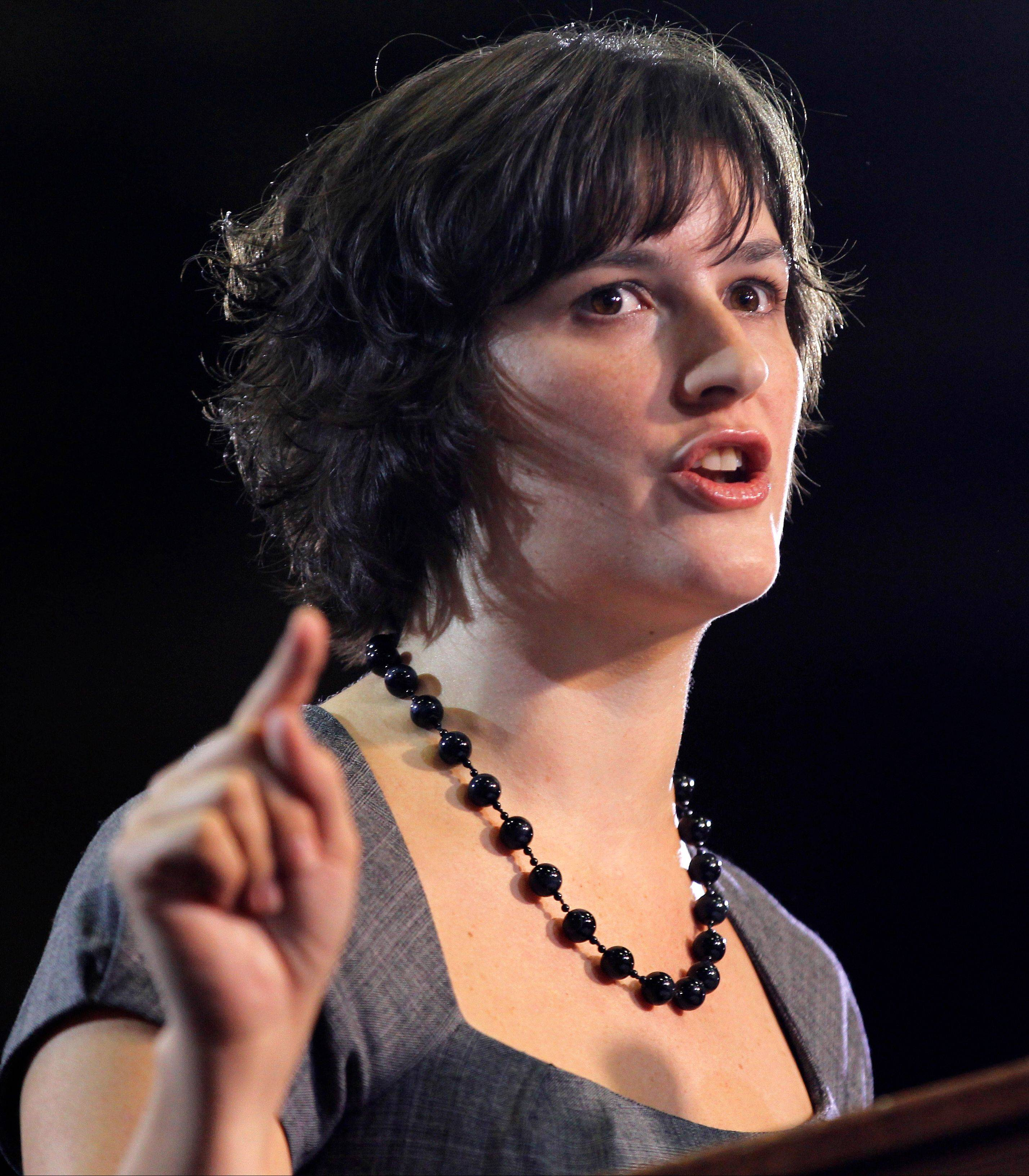 Sandra Fluke introduces President Barack Obama at a campaign event in Denver Wednesday. Fluke is a law student who gained notoriety when talk show host Rush Limbaugh spoke disparagingly of her testimony before Congress on the issue of contraception and insurance coverage.