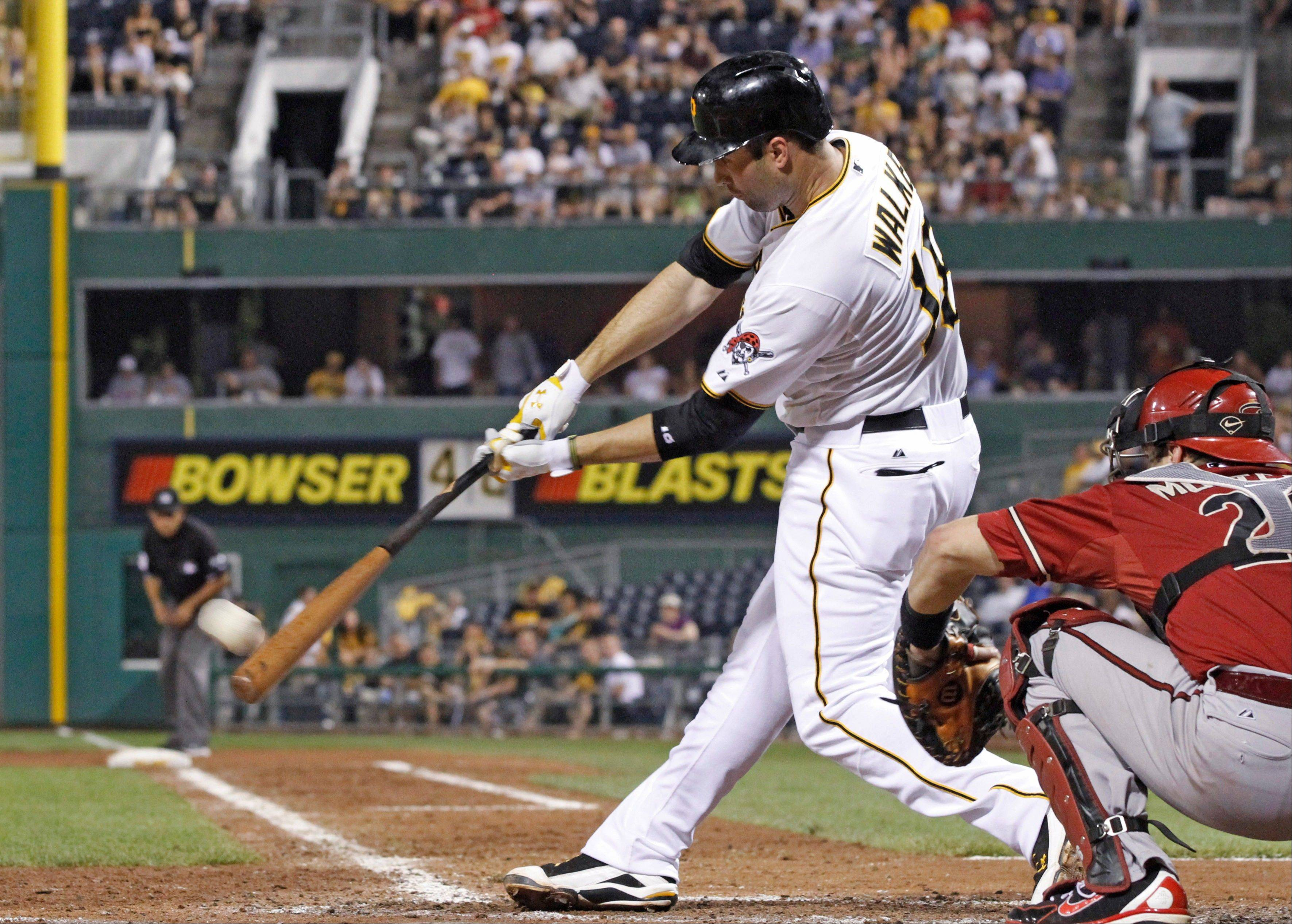 The Pirates' Neil Walker hits a double to drive in two runs in the fifth inning Wednesday at home against the Diamondbacks.