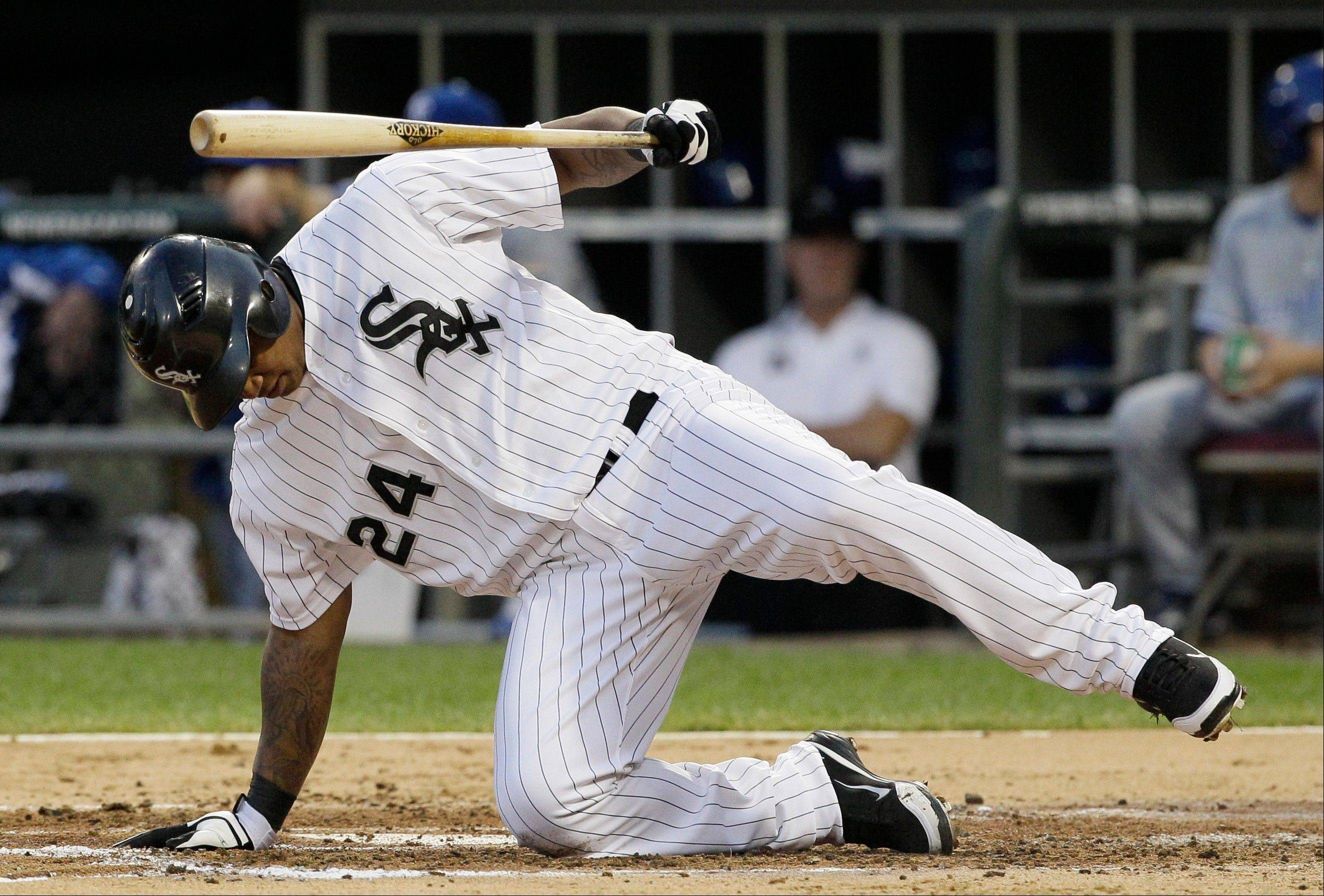 White Sox left fielder Dayan Viciedo falls down after swing a strike Wednesday during the second inning against the Kansas City Royals.