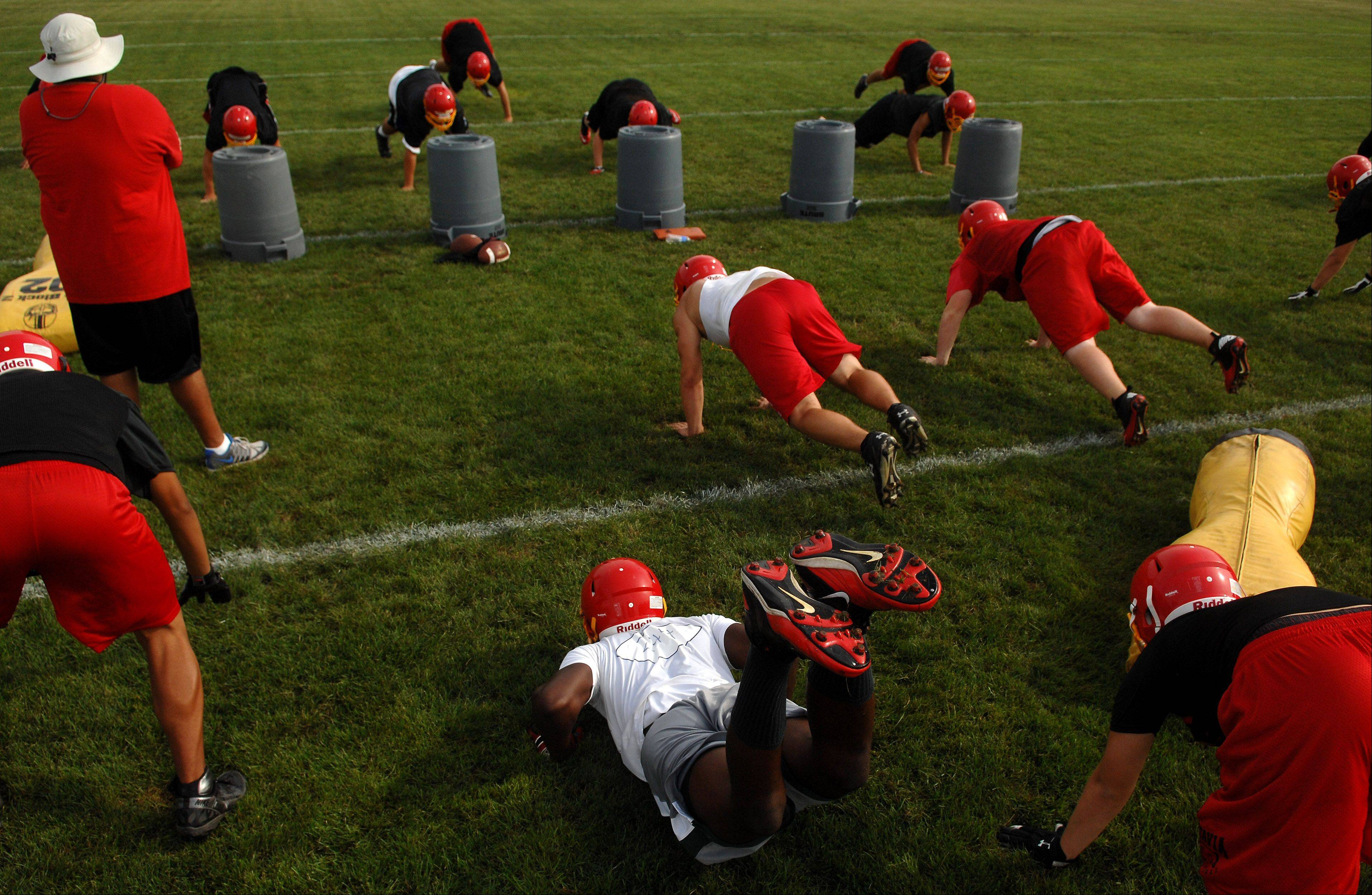 "Players do ""up and downs"" during practice during Batavia's first day of football practice Wednesday."