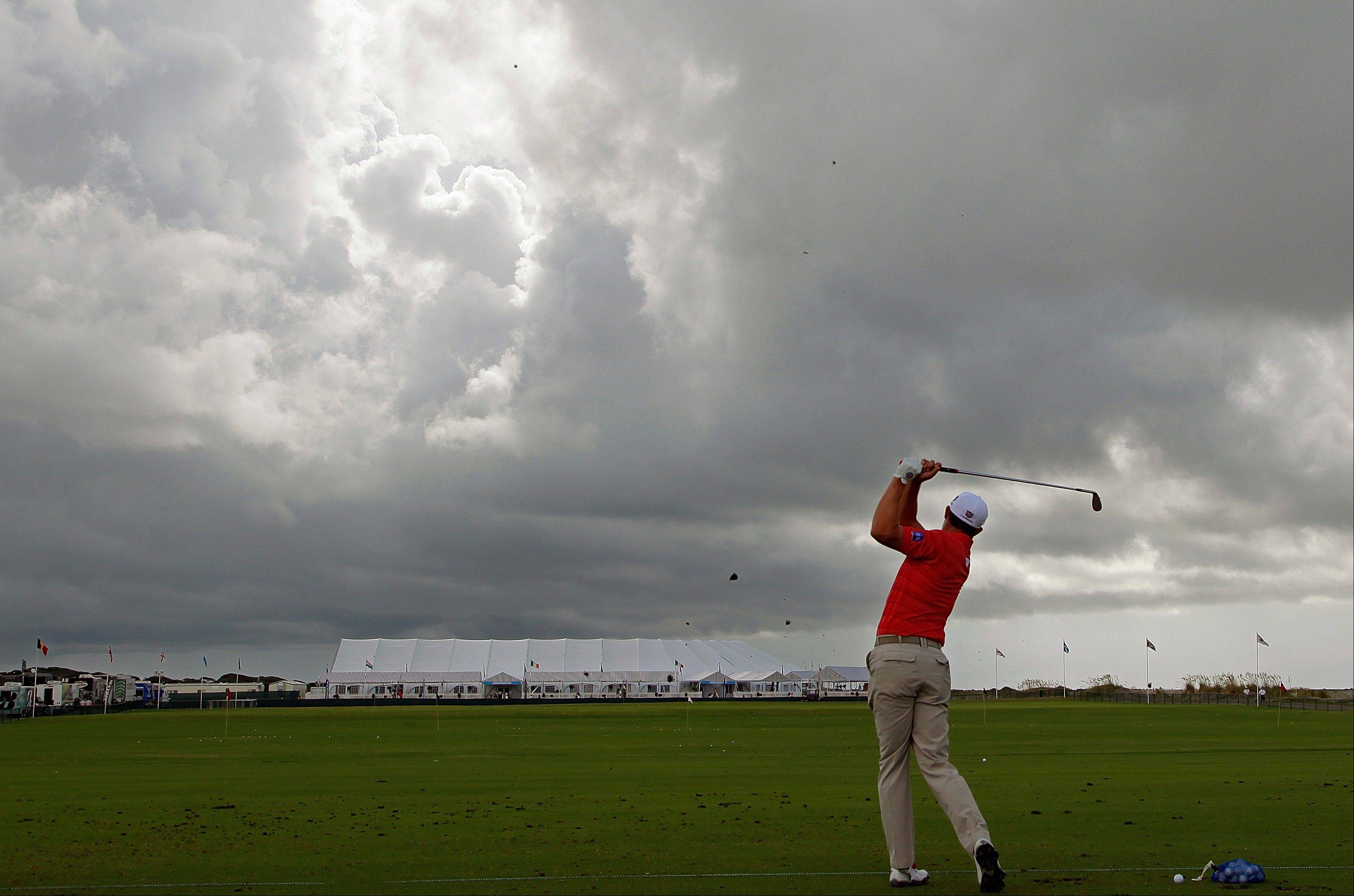 Padraig Harrington warms up on the driving range under storms clouds Tuesday during a practice round for the PGA Championship on the Ocean Course of the Kiawah Island Golf Club in Kiawah Island, S.C.