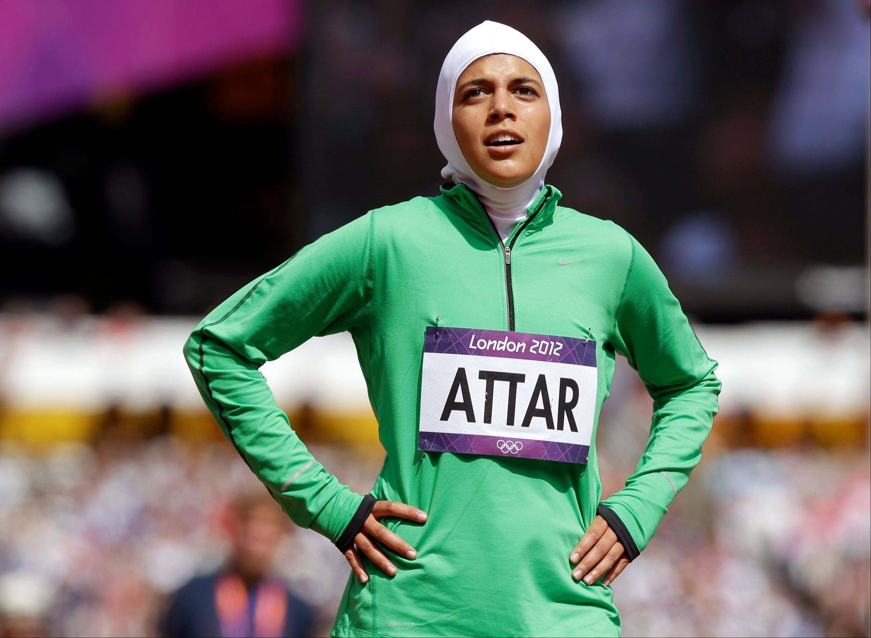 Saudi Arabia's Sarah Attar reacts after competing in a women's 800-meter heat during the athletics in the Olympic Stadium at the 2012 Summer Olympics, London, Wednesday, Aug. 8, 2012. Attar is the first Saudi woman to compete in track and field during the Olympics.