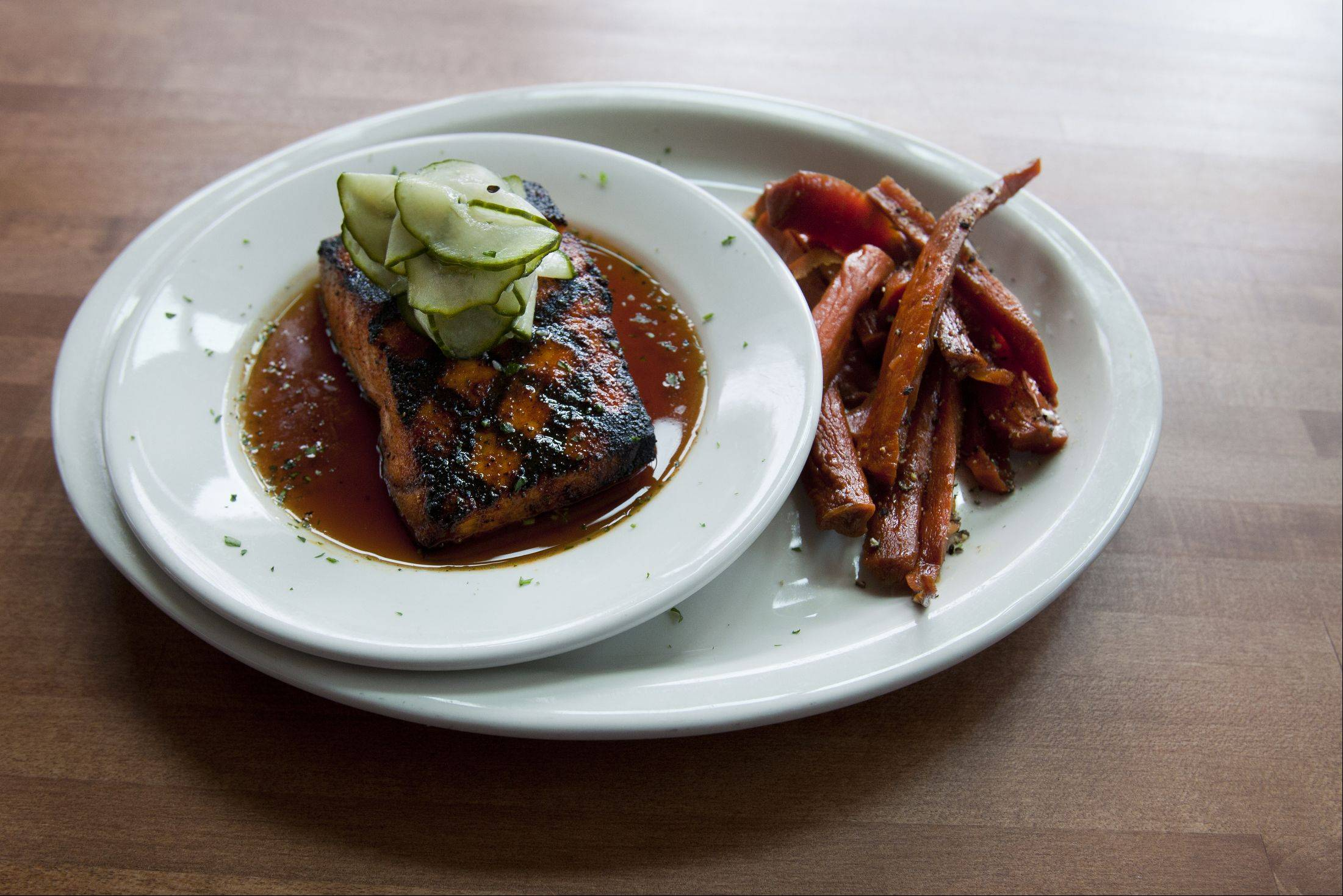 Citrus-Soy Salmon, shown here with honey roasted carrots, is Lincoln Whiskey Kitchen's award-winning recipe.
