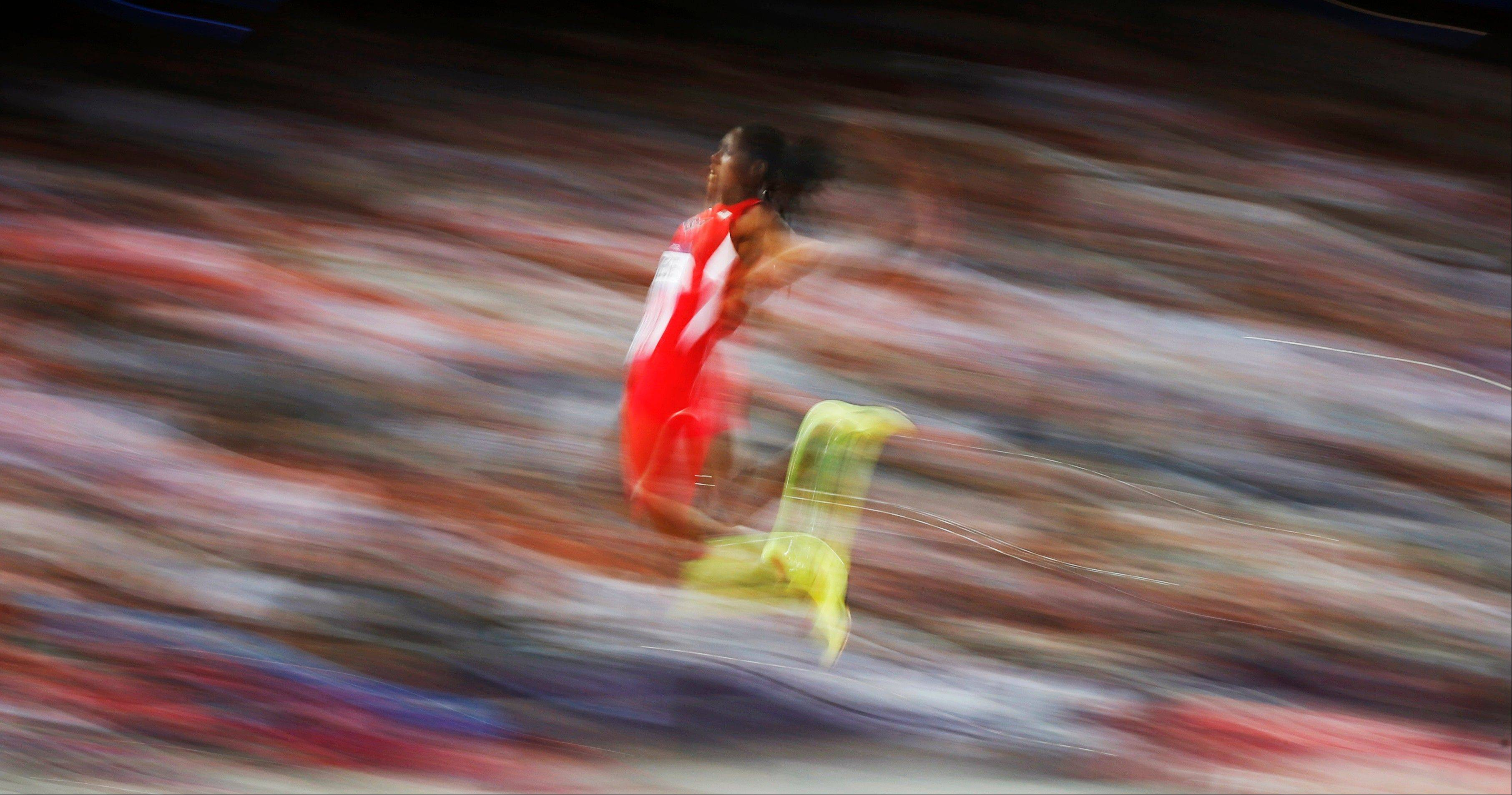 United States' Brittney Reese competes in the women's long jump final to win gold during the athletics in the Olympic Stadium at the 2012 Summer Olympics, London, Wednesday, Aug. 8, 2012.