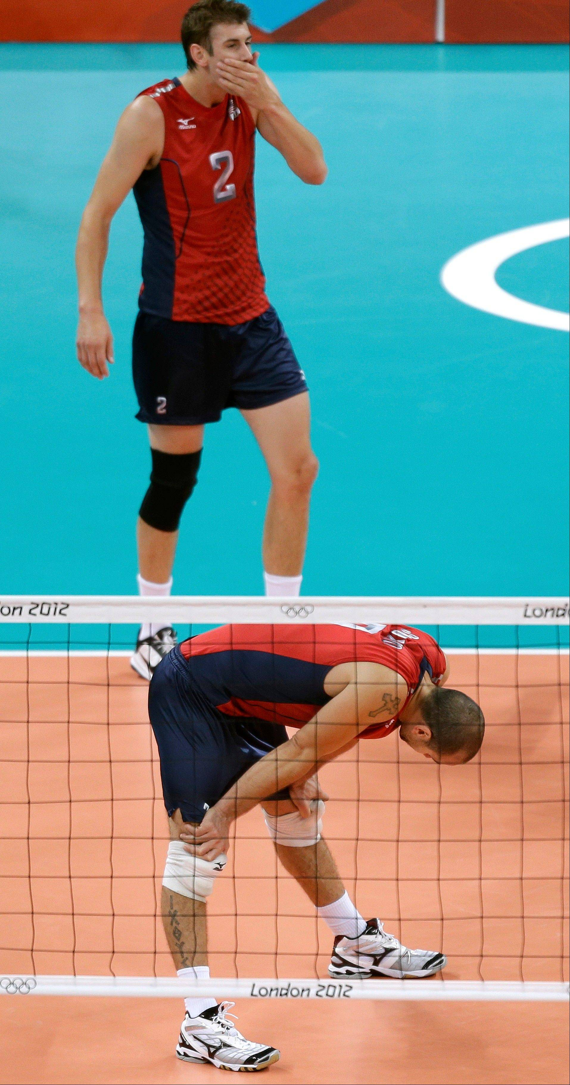 USA's Donald Suxho and Sean Rooney react after losing 3-0 to Italy during a men's volleyball quarterfinal match at the 2012 Summer Olympics Wednesday, Aug. 8, 2012, in London.
