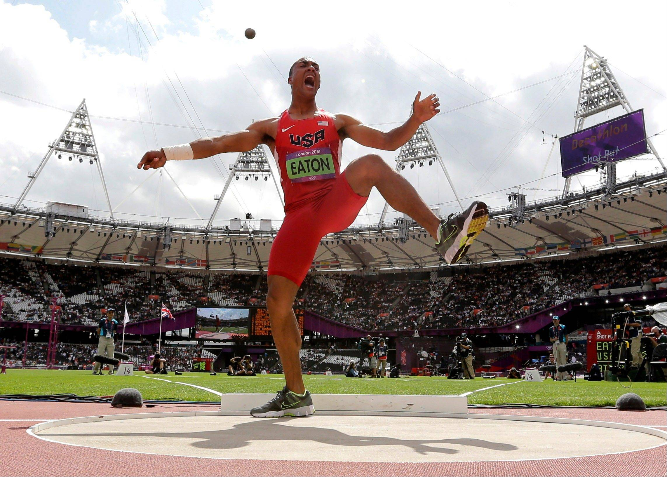 United States' Ashton Eaton reacts after his throw in the shot put in the decathlon during the athletics in the Olympic Stadium at the 2012 Summer Olympics, London, Wednesday, Aug. 8, 2012.