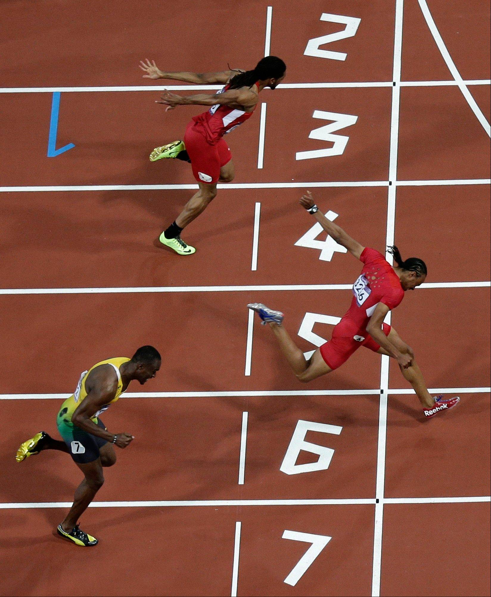 United States' Aries Merritt, right, beats teammate Jason Richardson, top and Jamaica's Hansle Parchment to win the men's 110-meter hurdles during the athletics in the Olympic Stadium at the 2012 Summer Olympics, London, Wednesday, Aug. 8, 2012.