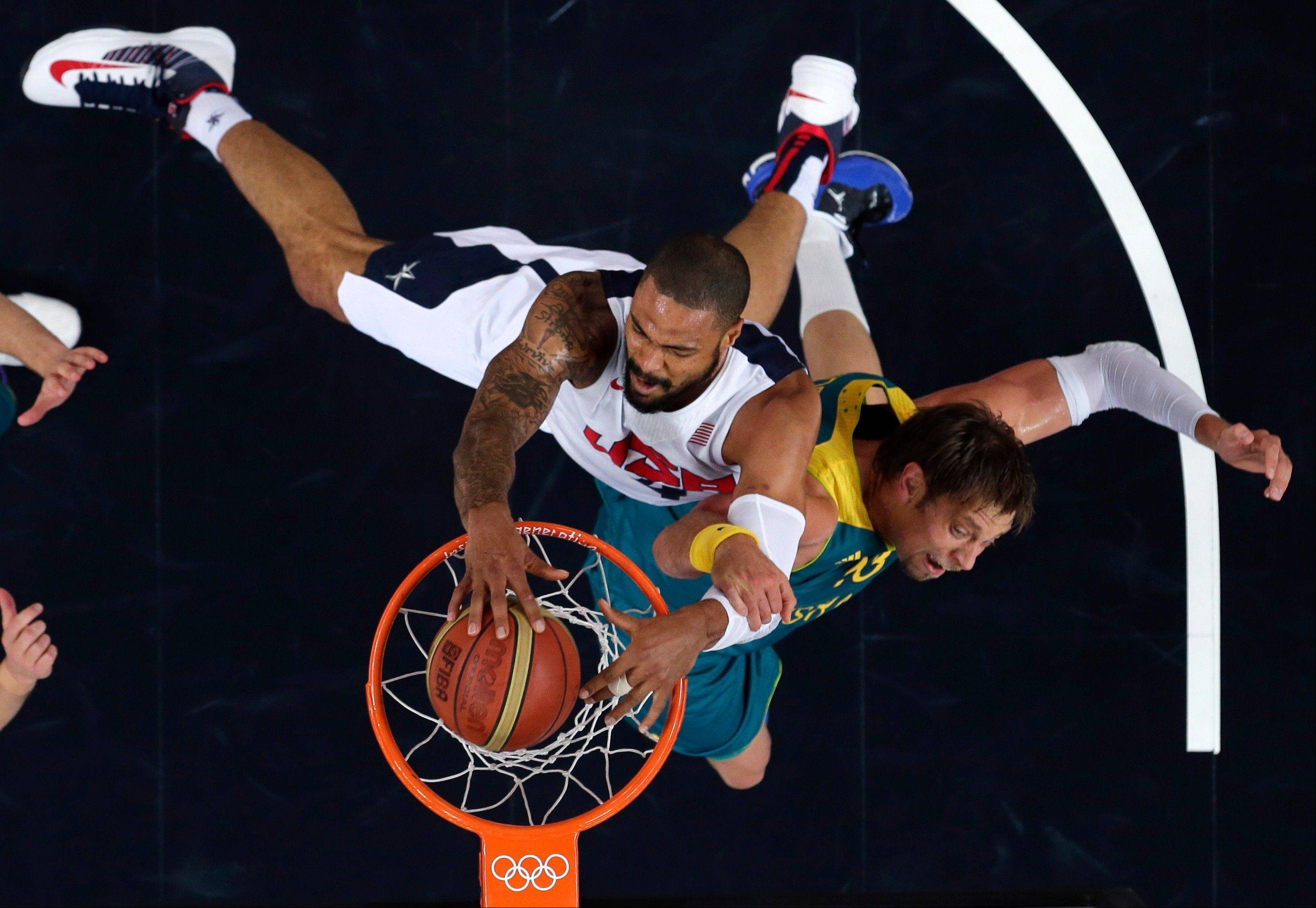 USA's Tyson Chandler slams a dunk against Australia's David Andersen during a men's quarterfinals basketball game at the 2012 Summer Olympics, Wednesday, Aug. 8, 2012, in London.