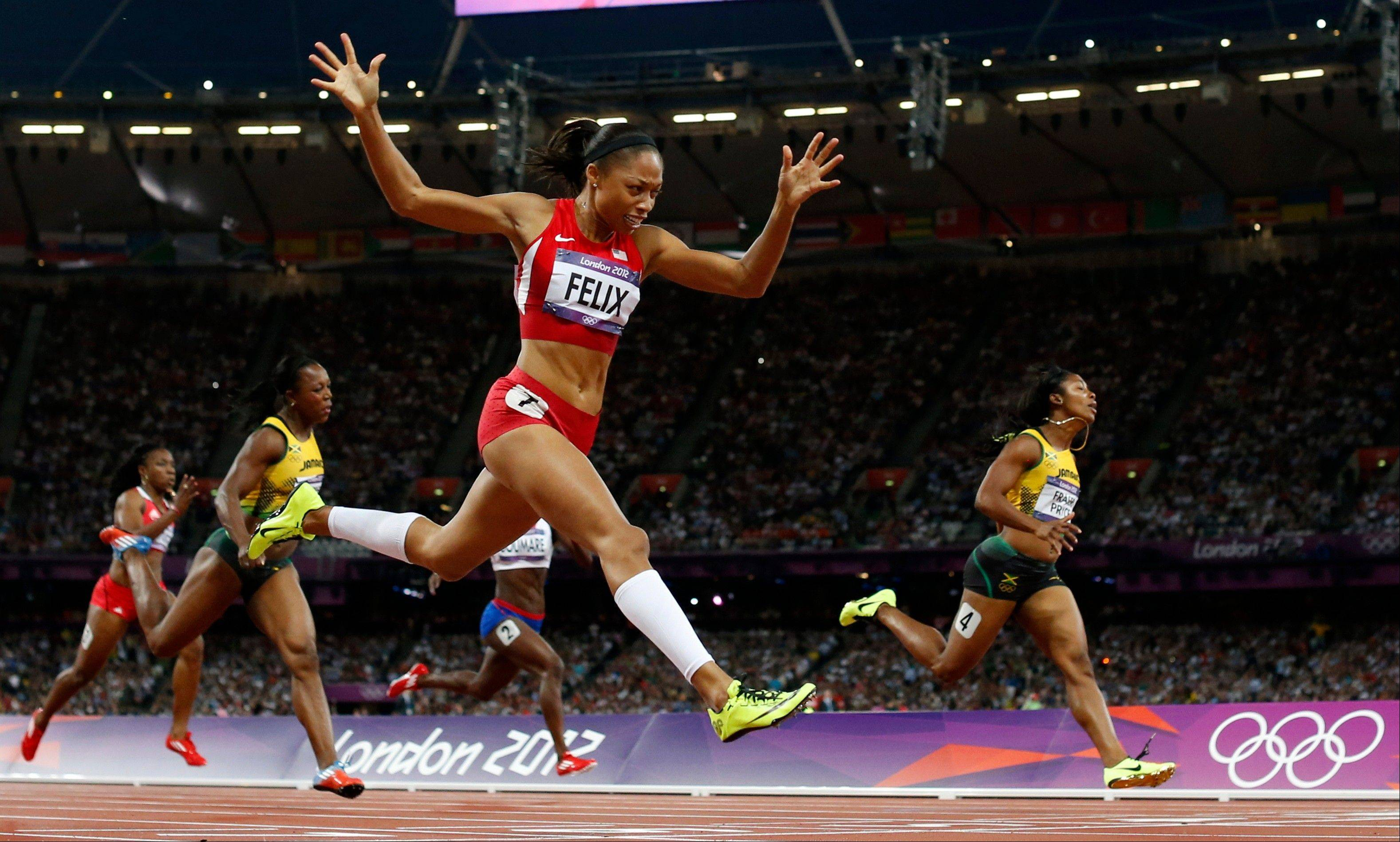 United States' Allyson Felix, second from right, crosses the finish line to win gold ahead of Jamaica's Shelly-Ann Fraser-Pryce, right, in the women's 200-meter final during the athletics in the Olympic Stadium at the 2012 Summer Olympics, London, Wednesday, Aug. 8, 2012.