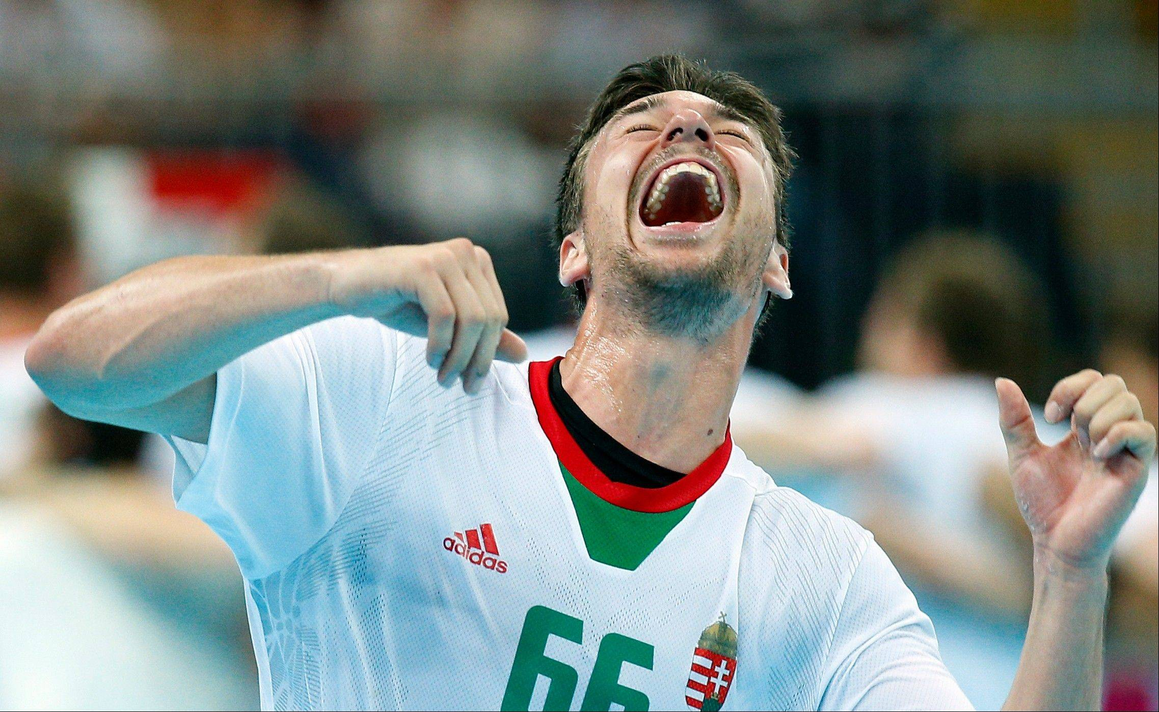 Hungary's Mate Lekai reacts after his team defeated Iceland during their men's handball quarterfinal match at the 2012 Summer Olympics, Wednesday, Aug. 8, 2012, in London.
