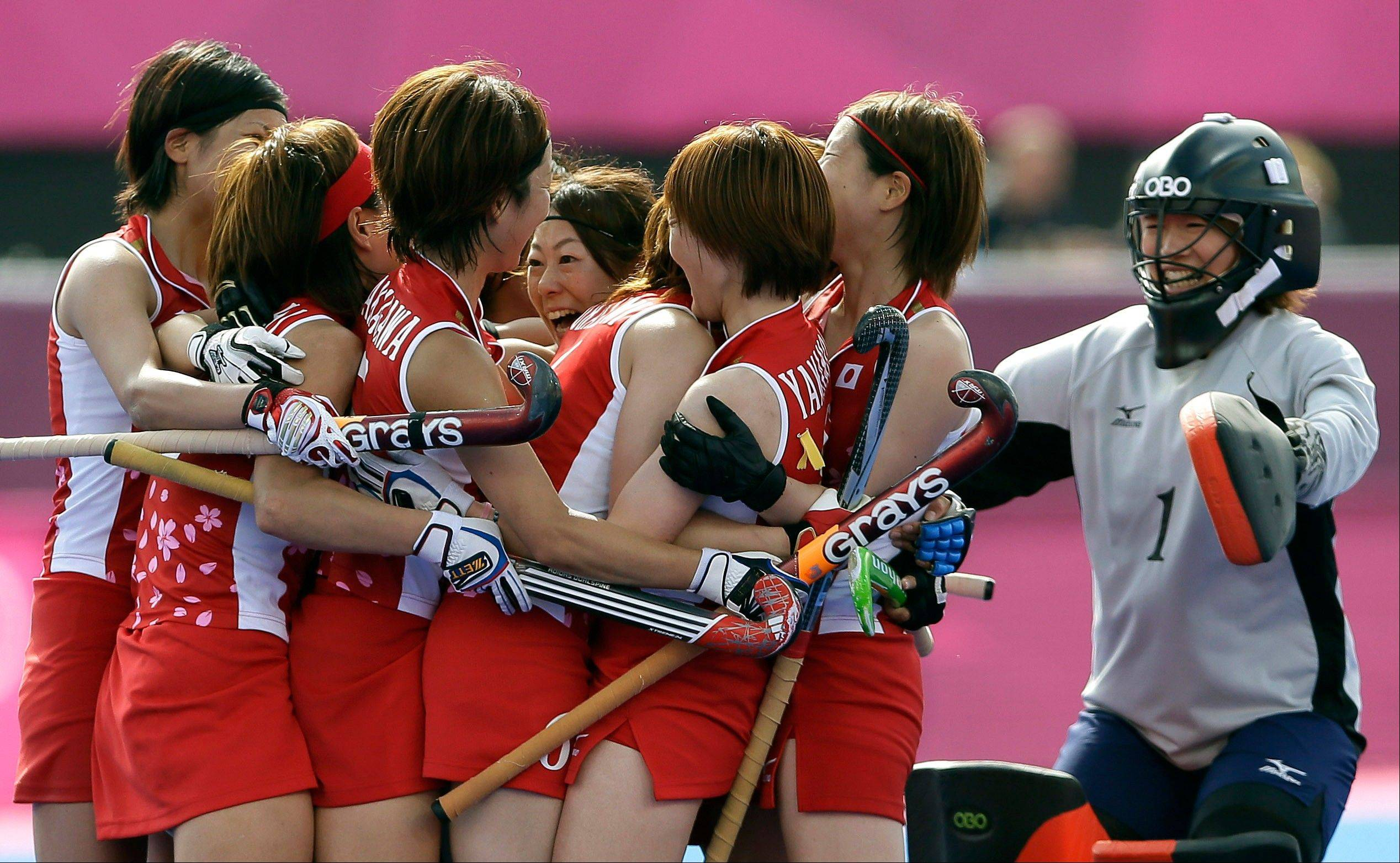 Japan's players celebrate winning their classification hockey match against South Africa at the Riverside Arena at the 2012 Summer Olympics, London, Wednesday, Aug. 8, 2012.