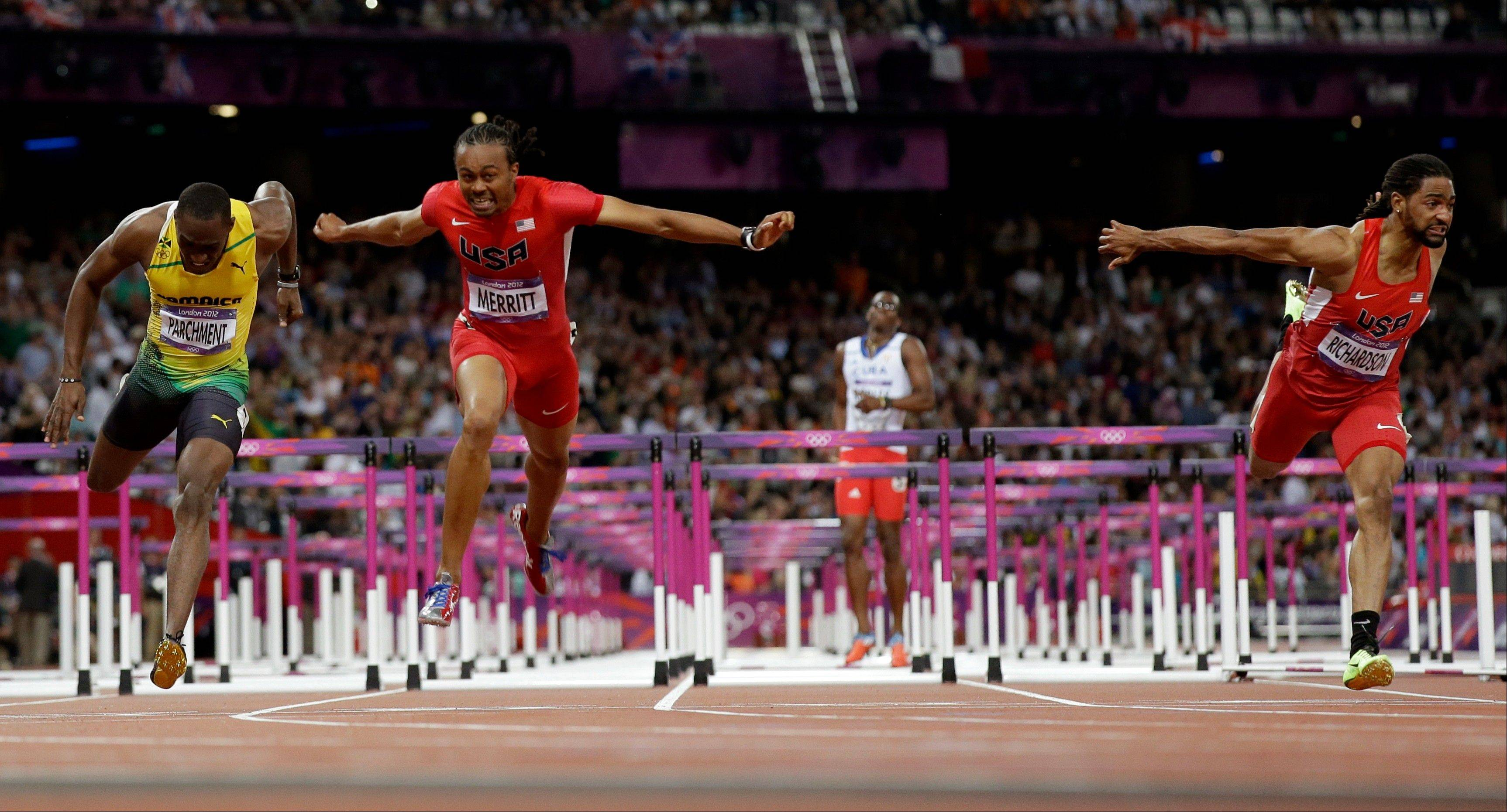 United States' Aries Merritt, second from left, crosses the finish line ahead of United States' Jason Richardson, right, and Jamaica's Hansle Parchment, left, to win gold in the men's 110-meter hurdles final
