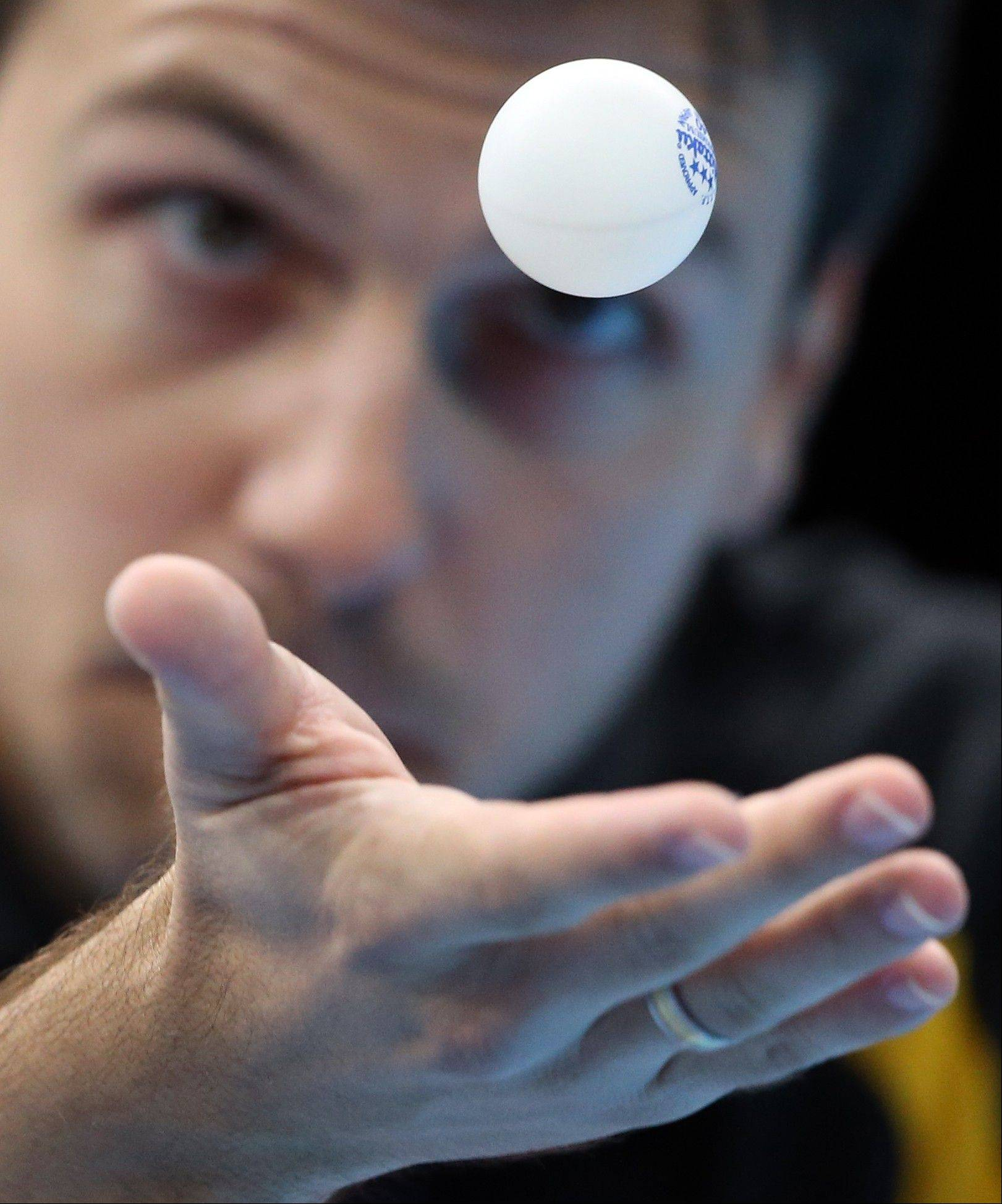 Timo Boll of Germany competes against Leung Chu Yan of Hong Kong in the men's team table tennis bronze medal match at the 2012 Summer Olympics, Wednesday, Aug. 8, 2012, in London.