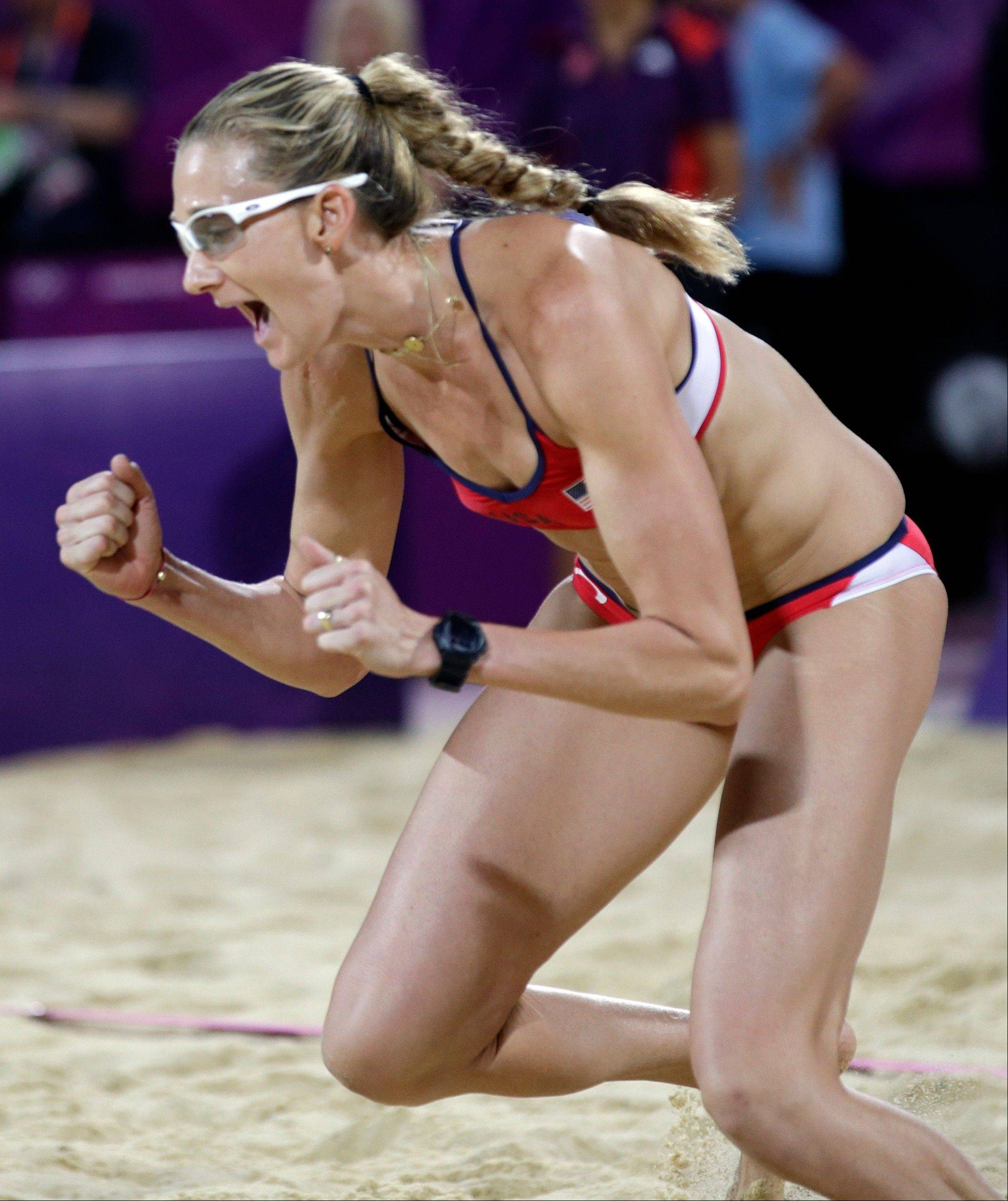 Kerri Walsh Jennings reacts after scoring a point Wednesday during the women's Gold Medal beach volleyball match.