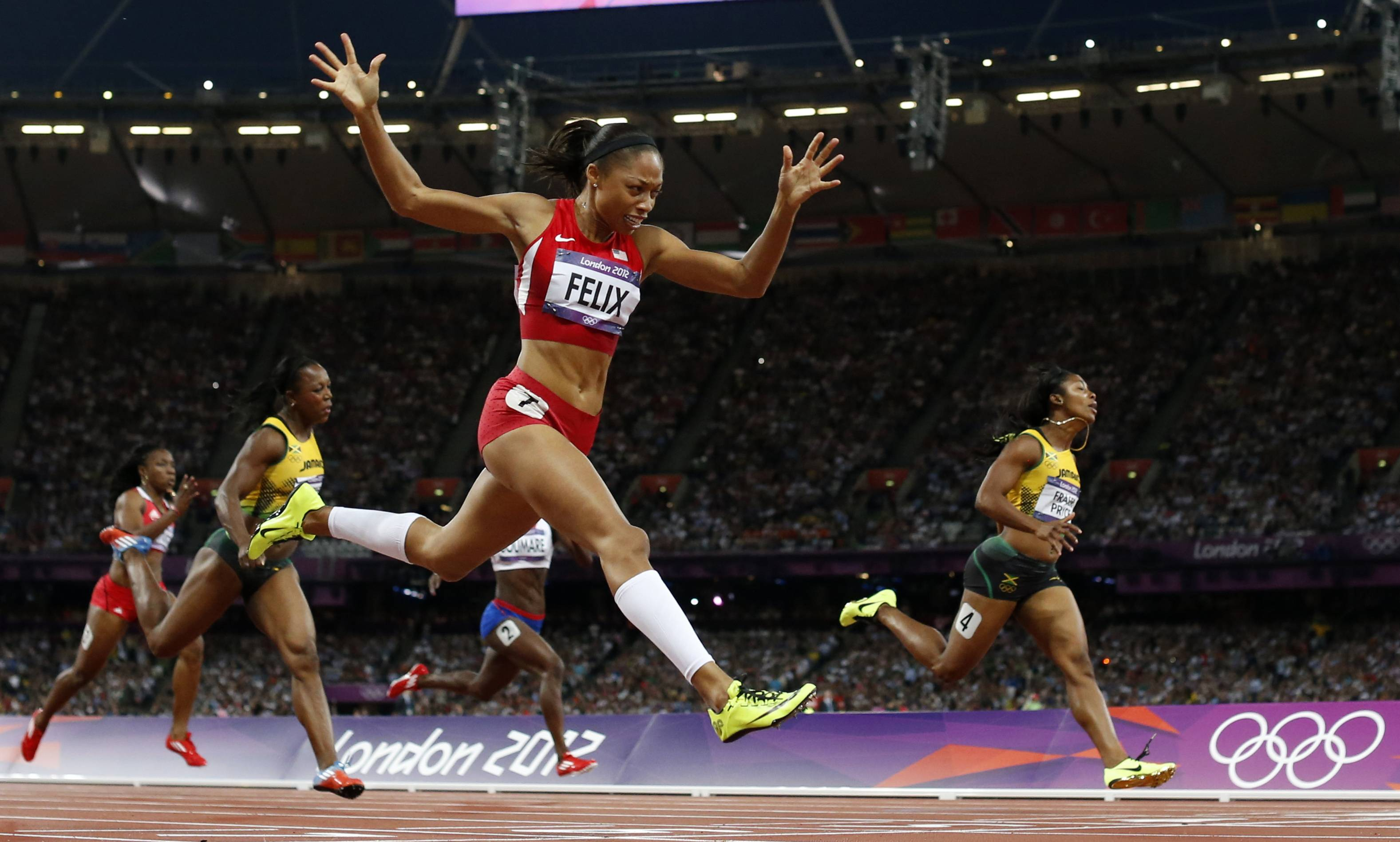 United States sprinter Allyson Felix, second from right, crosses the finish line to win gold ahead of Jamaica's Shelly-Ann Fraser-Pryce, right, in the women's 200-meter final.