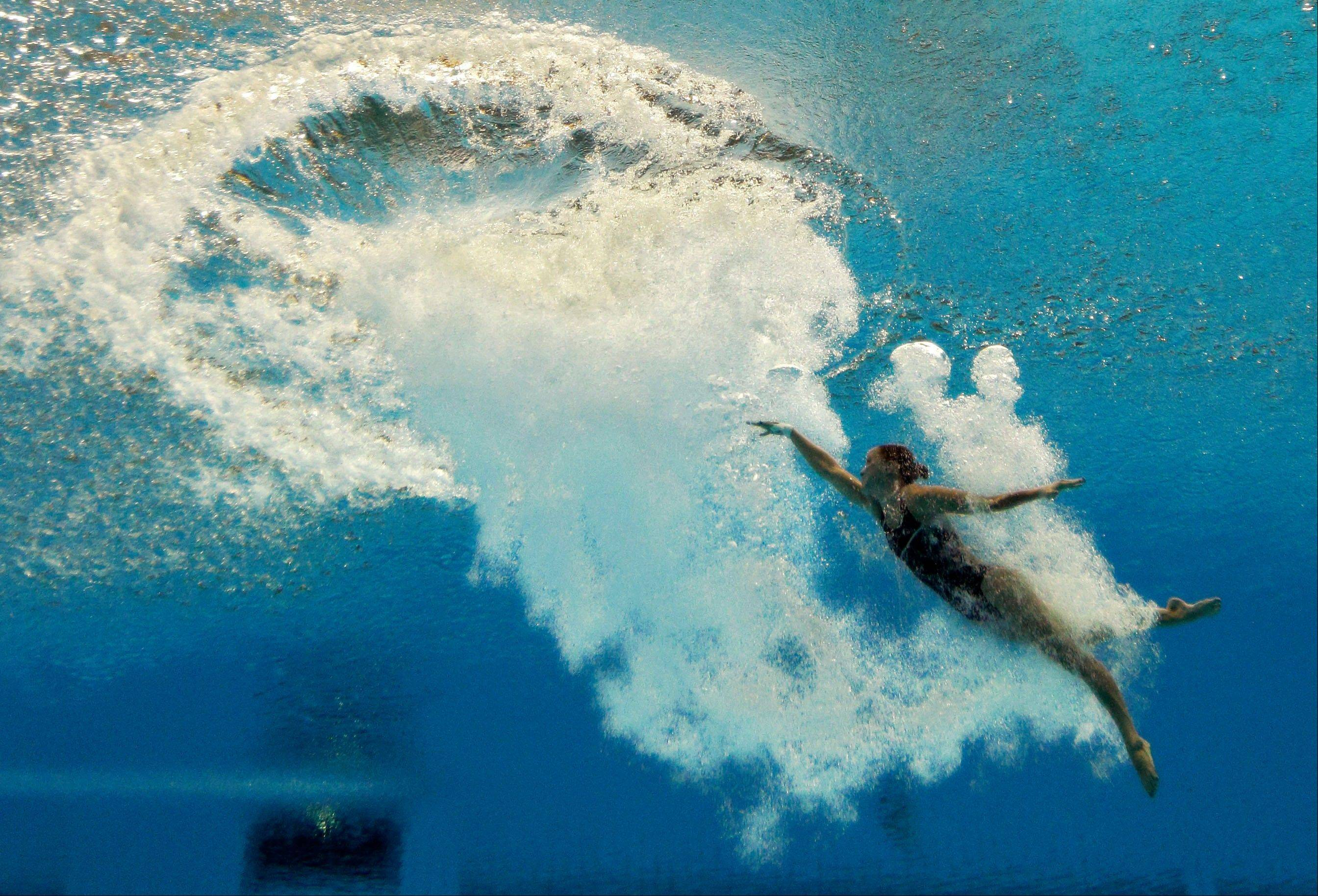 Katie Bell of the United States dives during the women�s 10-meter platform diving semifinal at the Aquatics Centre in the Olympic Park during the 2012 Summer Olympics in London, Thursday, Aug. 9, 2012.
