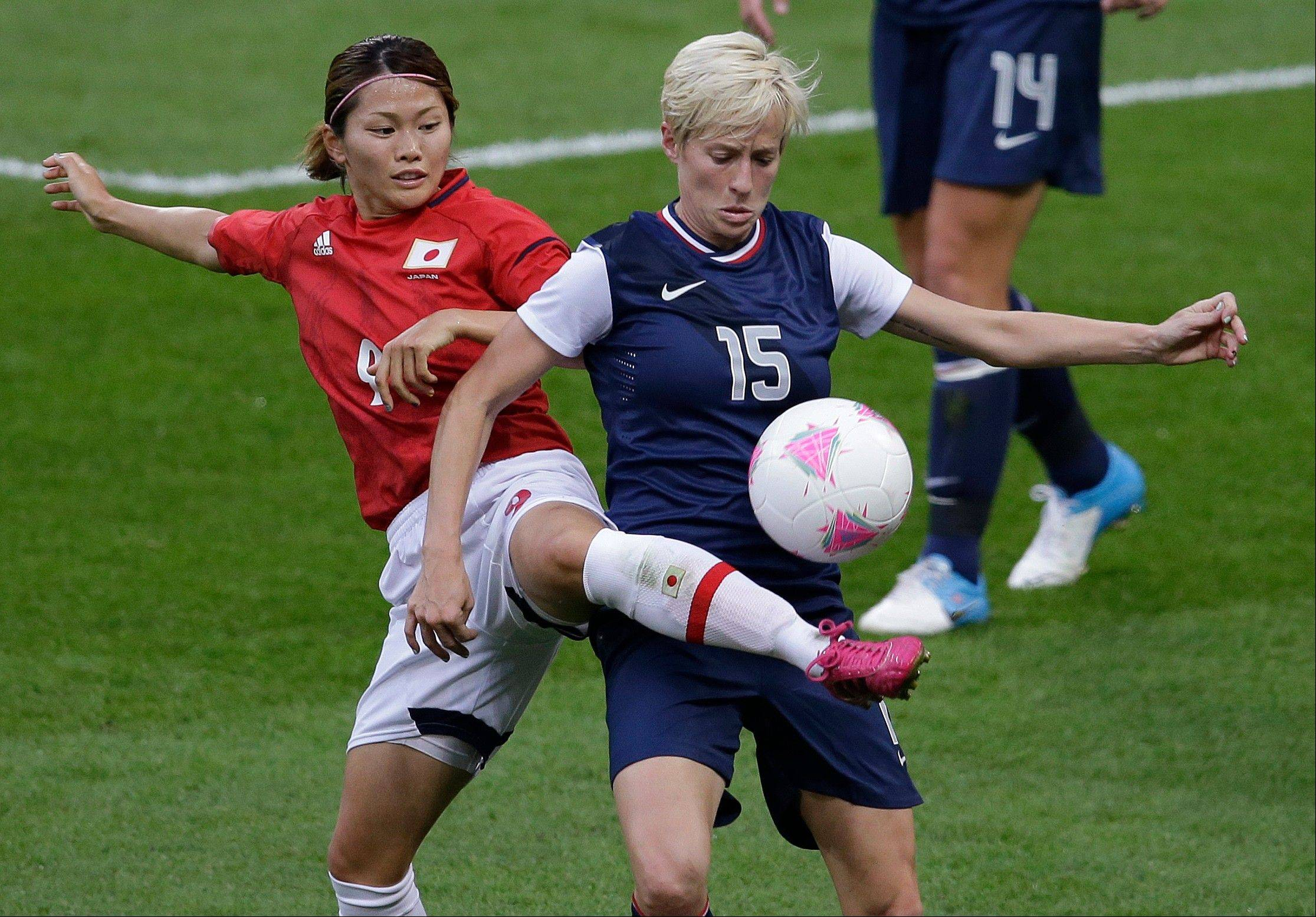 Megan Rapinoe, right, fights for possession of the ball during the women�s soccer gold medal match at the London Olympics Thursday. Rapinoe, one of the stars of the U.S. team, is one of few Olympic athletes to have publicly stated they are gay.
