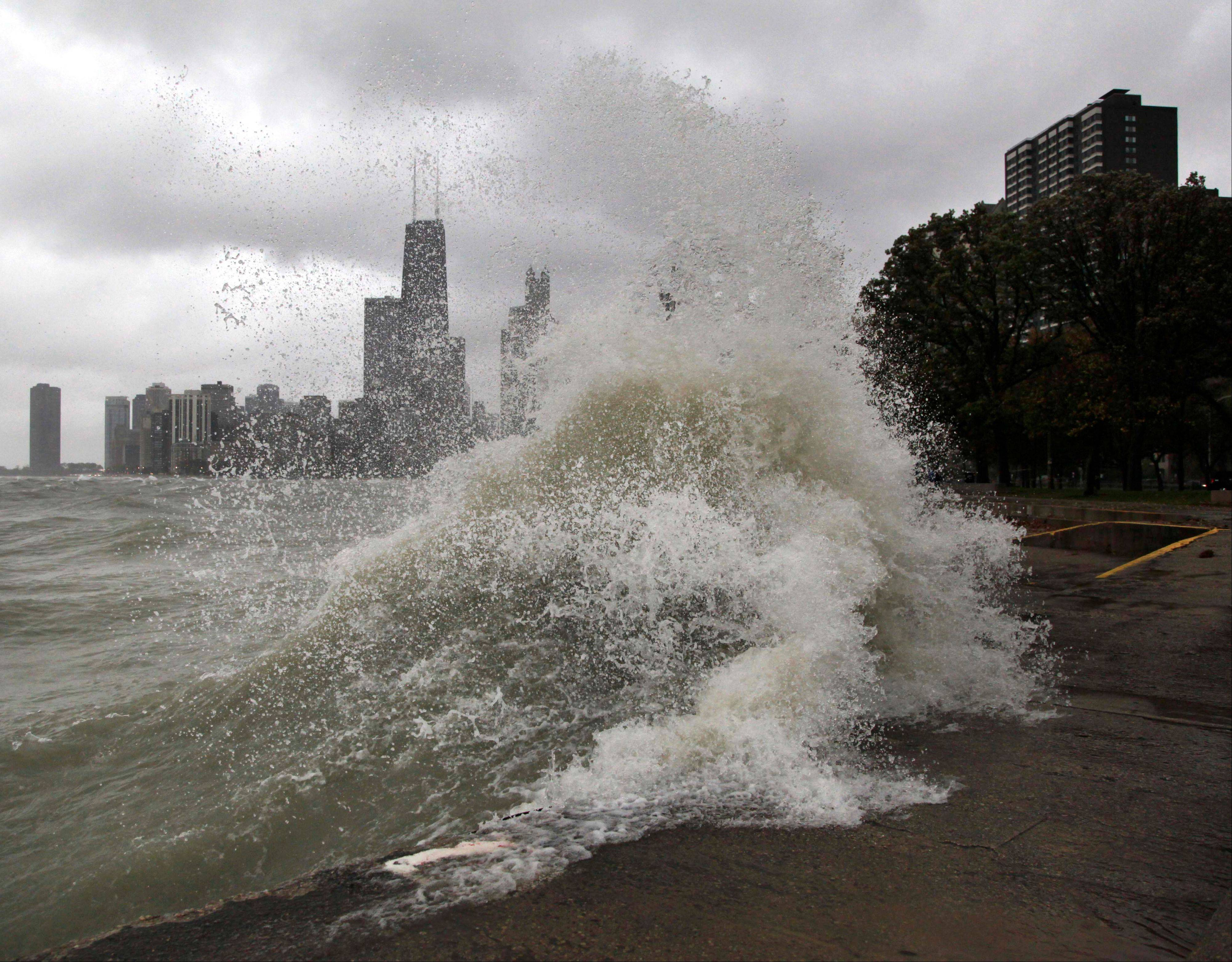 Waves crash along the Lake Michigan bike path wall at Chicago's North Ave. beach in this October, 2011 file photo. Waters will be especially rough during Thursday evening through Friday on the south end of Lake Michigan. Winterlike wave action is forecast from Milwaukee through Chicago, Gary, Ind., and Benton Harbor, Mich.