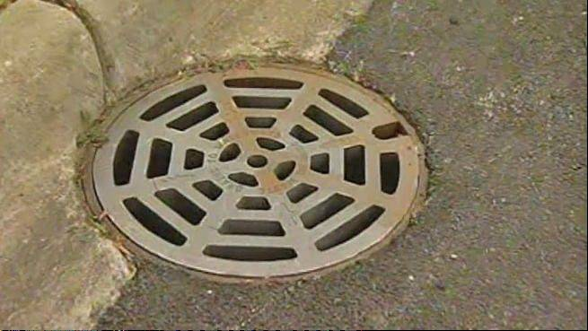 This is the manhole a 76-year-old woman fell through Monday morning.